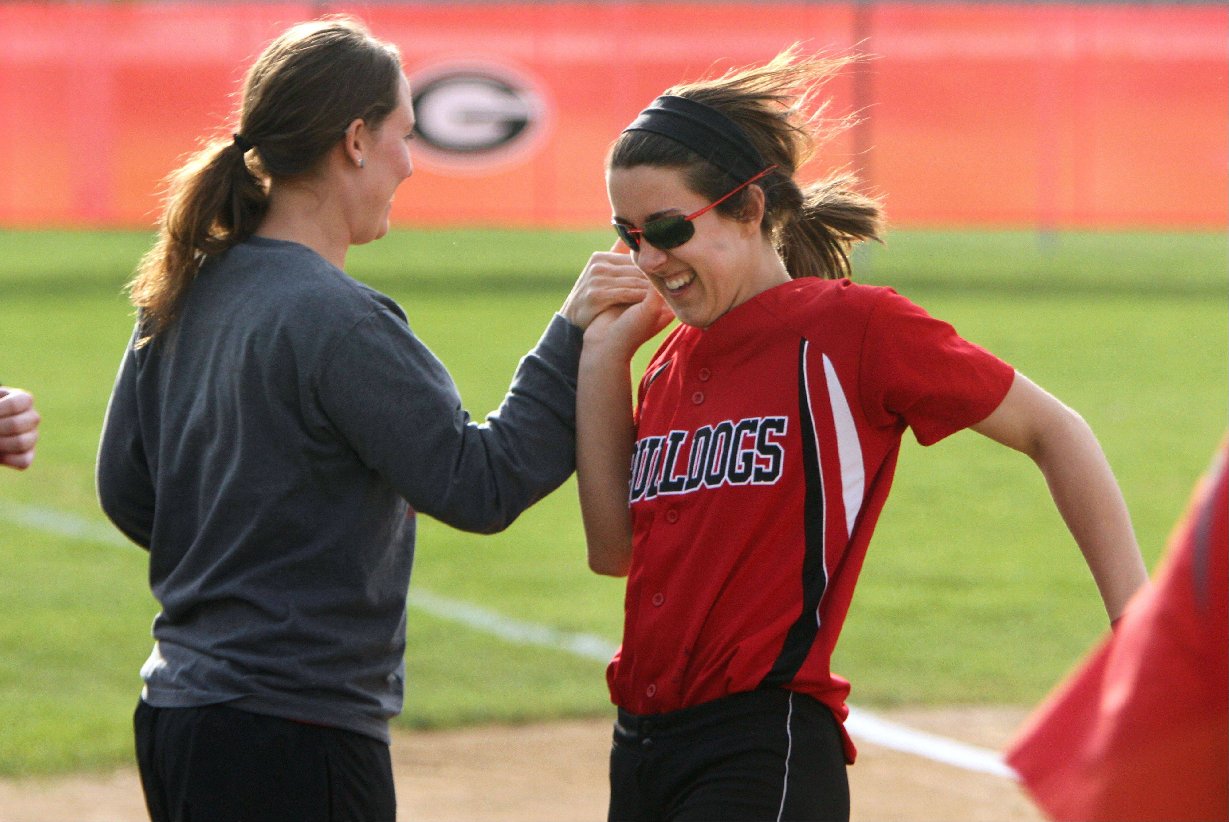 Grant pitcher Caitlyn Moran gets a high five after she and her teammates defeated Wauconda on Monday at Grant.