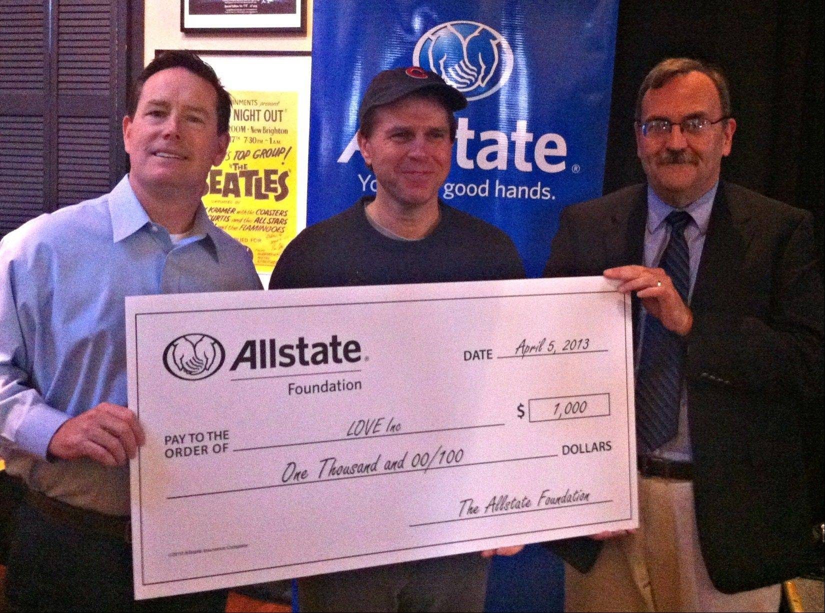 "Walter Sheldon, from left, Bill Leff, and Carl ""Spark"" Ball of Love Inc. receive a $1,000 grant from Allstate."