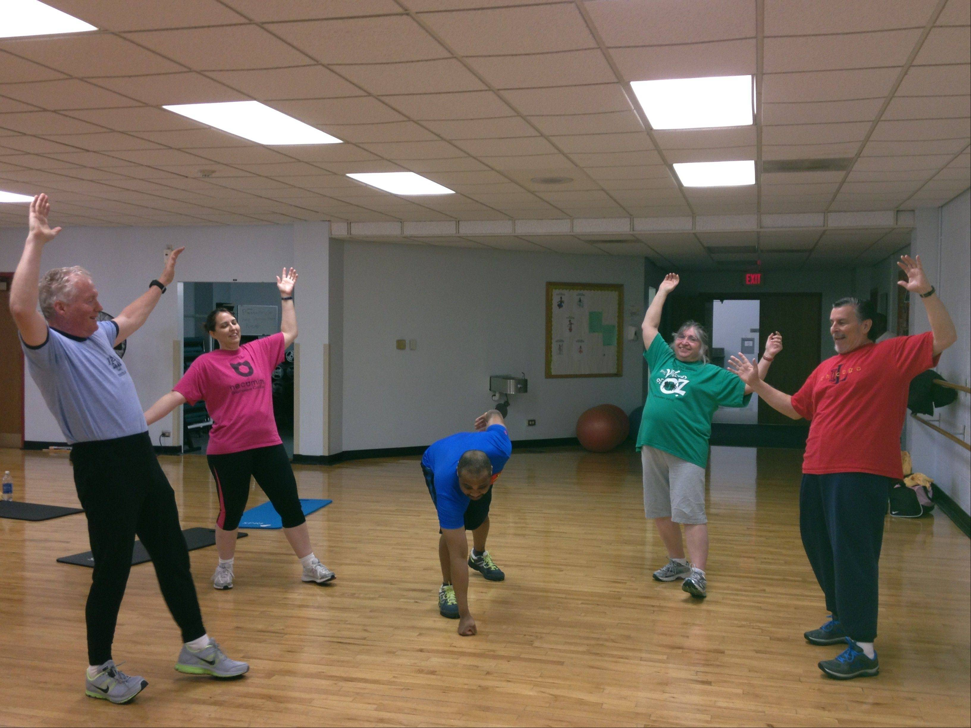 The Schaumburg Waist Management team works out with trainer Lee Collins.
