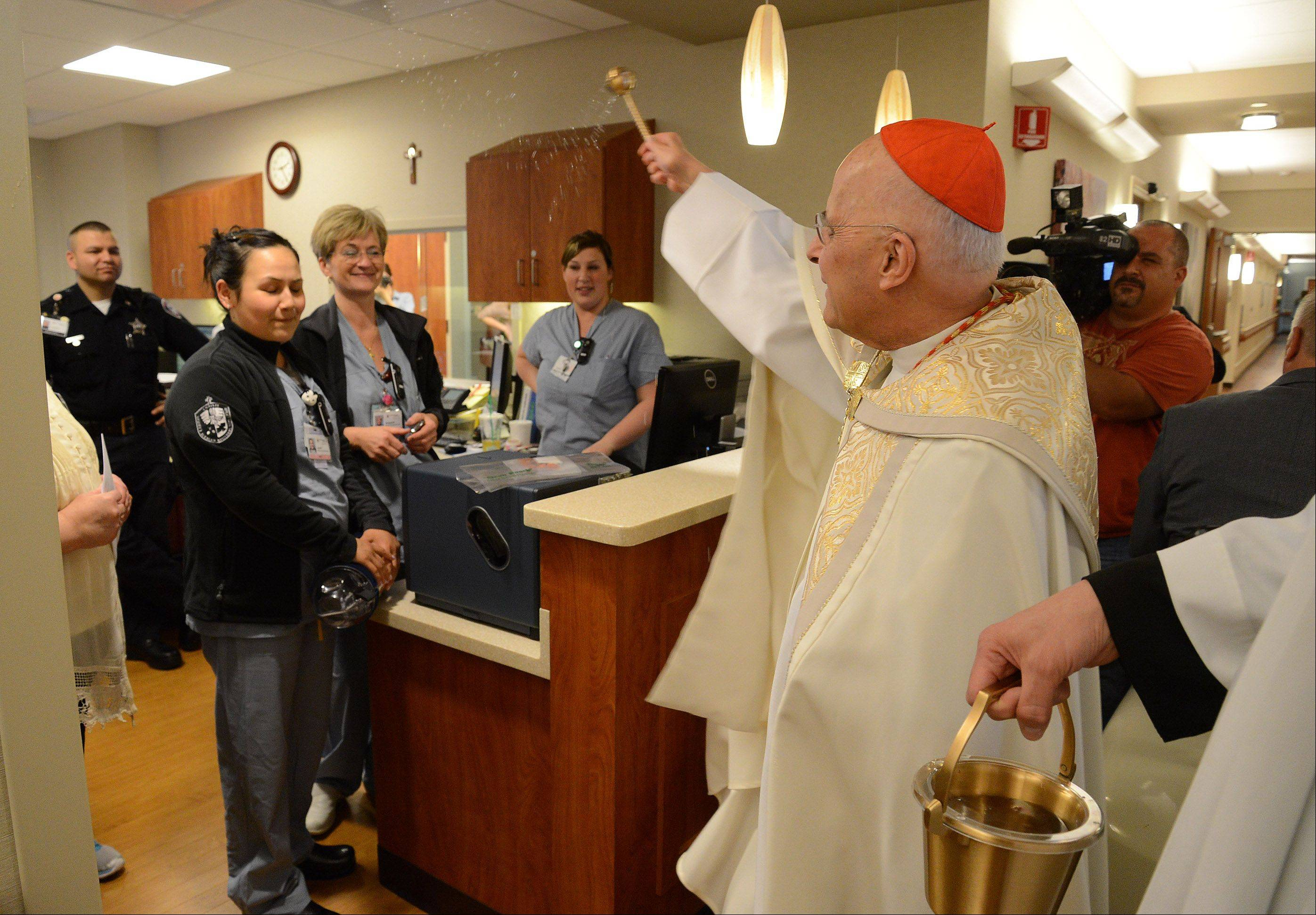 Cardinal Francis George blesses the staff, patients and families of the new Alexian Brothers Women and Children's Hospital in Hoffman Estates on Monday.