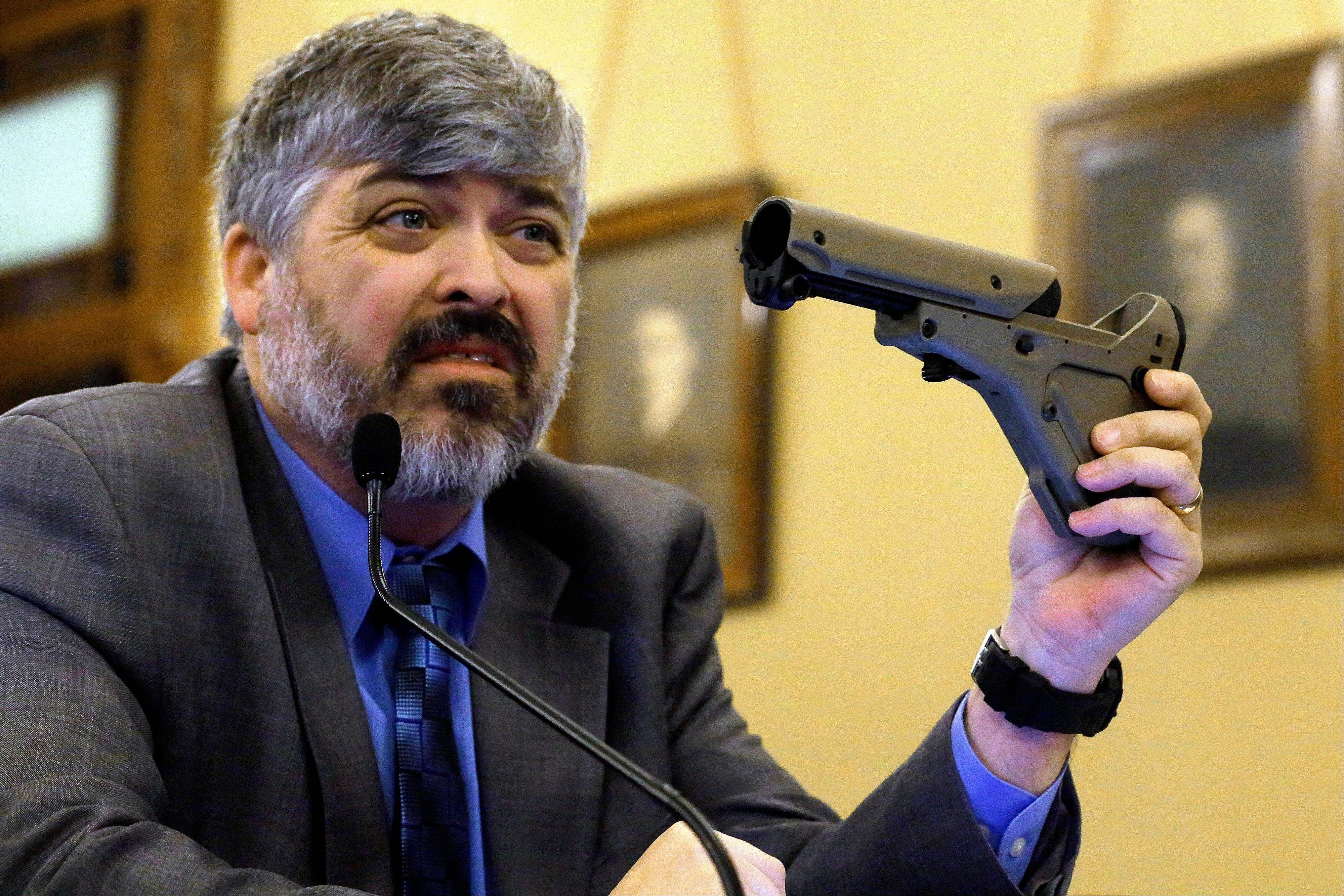 Todd Vandermyde of the NRA shows a gun stock during a committee hearing on assault weapons in February at the Capitol in Springfield. The Senate has a concealed carry bill that maybe a compromise between Chicago lawmakers fighting street violence and downstate moderates who want easier access to guns.