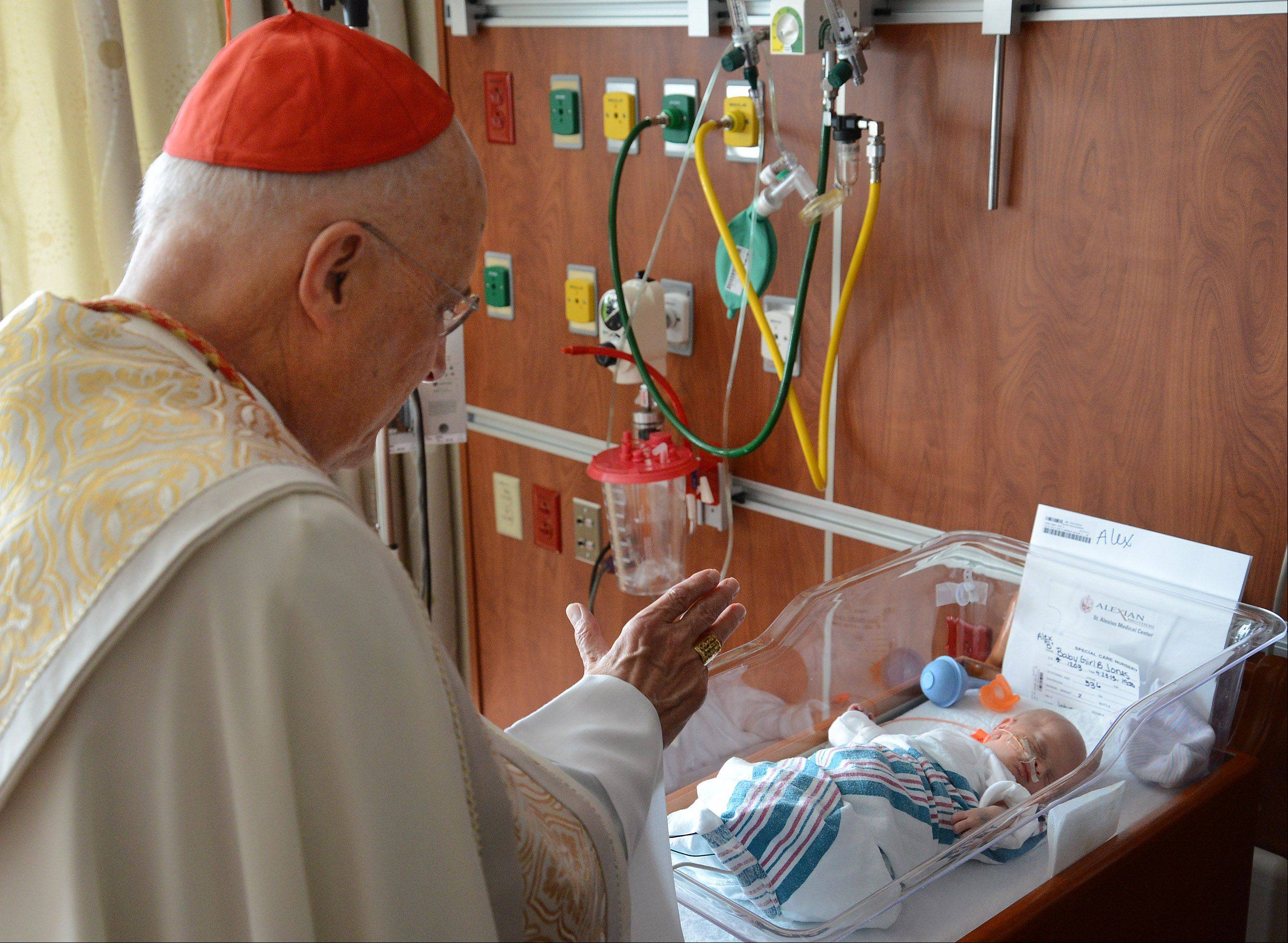 Cardinal Francis George blesses Alexandra Jones of Elk Grove Village, who was born prematurely, on Monday at Alexian Brothers' new Women & Children's Hospital in Hoffman Estates.