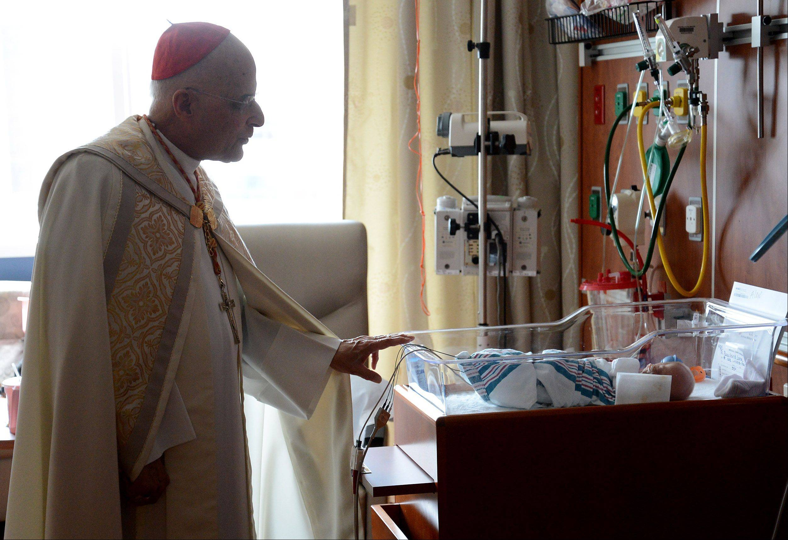 Cardinal Francis George blesses Alexandra Jones, born prematurely. George visited the staff, patients and families of the new Alexian Brothers Women & Children's Hospital in Hoffman Estates on Monday.