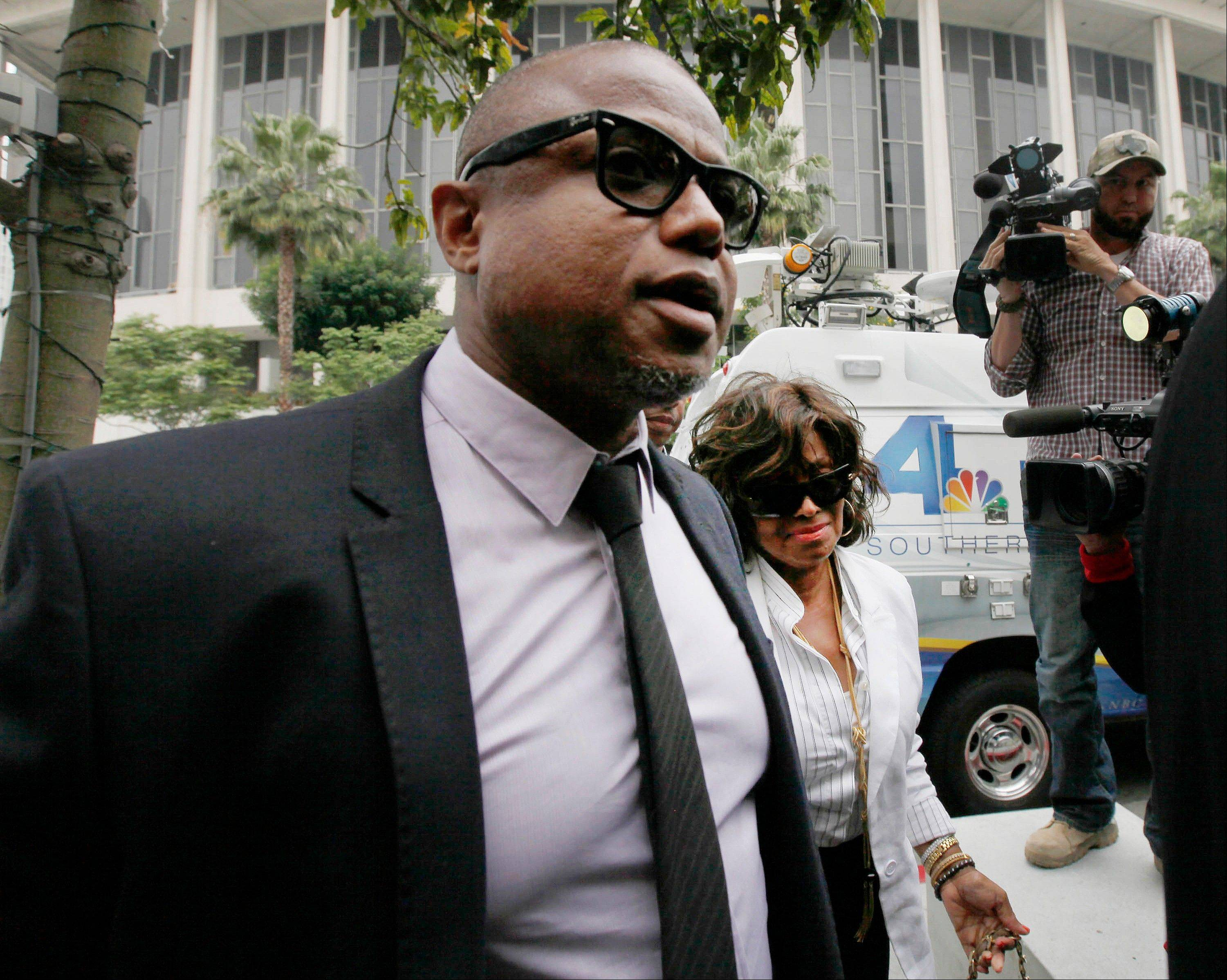 Randy Jackson and Rebbie Jackson, background right, brother and sister of late pop star Michael Jackson, arrive at a courthouse for Katherine Jackson's lawsuit against concert giant AEG Live in Los Angeles, Monday.