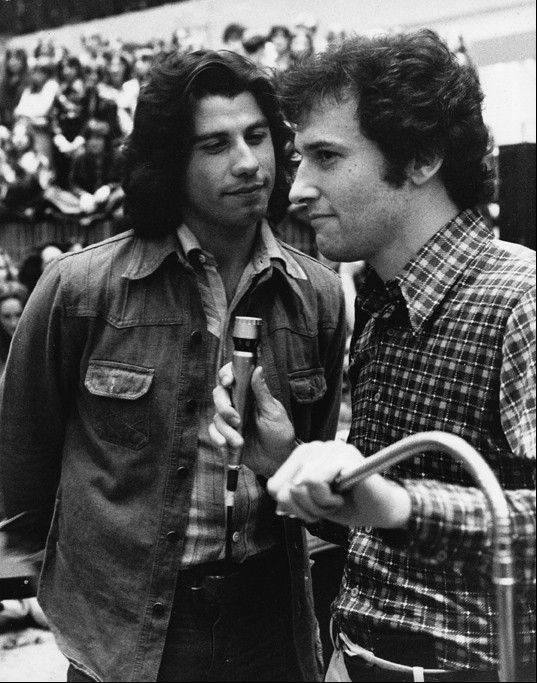 Chicago radio personality John Records Landecker joined a young John Travolta at a chaotic 1976 promotional appearance at Woodfield Mall in Schaumburg. A few thousand were expected at the event, but an estimated 30,000 showed up.