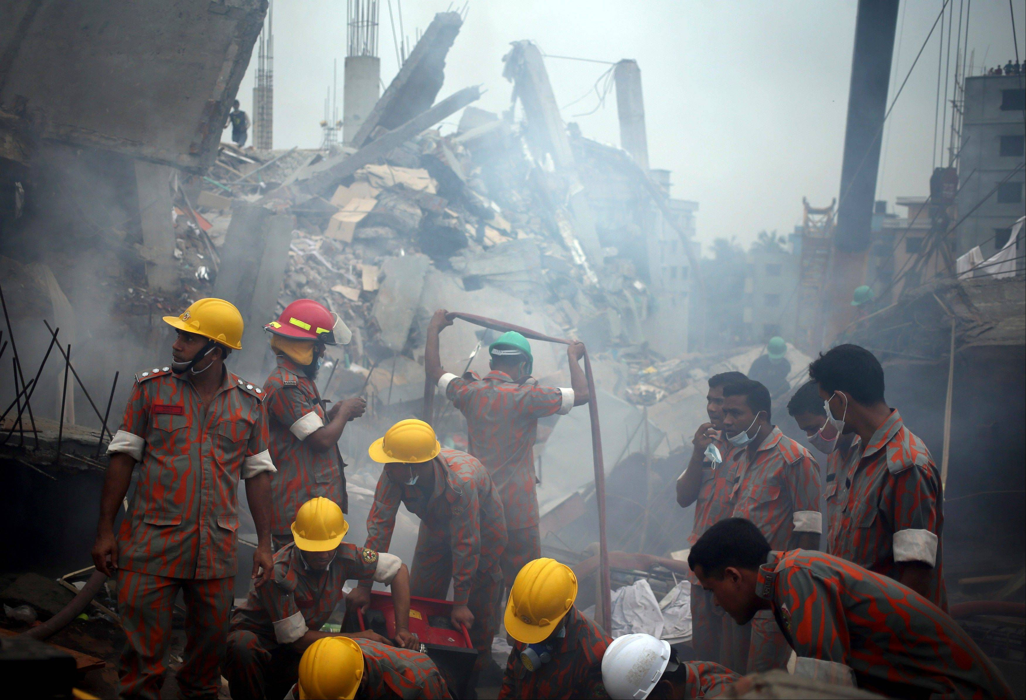 On Monday rescue workers gave up hopes of finding any more survivors in the remains of a building that collapsed five days ago, and began using heavy machinery on Monday to dislodge the rubble and look for bodies -- mostly of workers in garment factories there. At least 381 people were killed when the illegally constructed, 8-story Rana Plaza collapsed in a heap on Wednesday morning along with thousands of workers in the five garment factories in the building.
