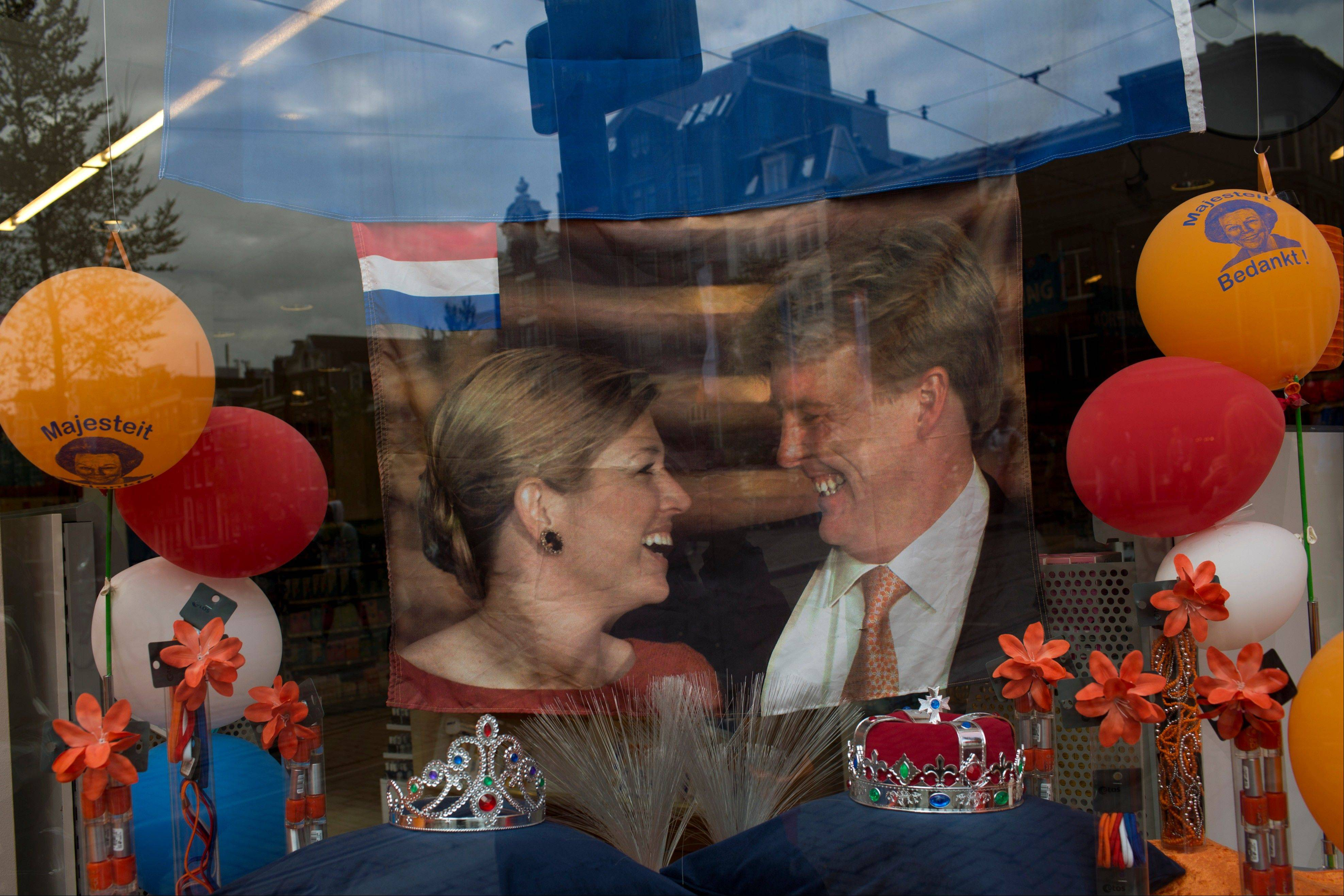 A flag bearing the image of Dutch Crown Prince Willem-Alexander and his wife, Princess Maxima, is placed on display in a show window along with other Royal memorabilia in downtown Amsterdam, Netherlands, on Monday. Dutch Queen Beatrix has announced she will relinquish the crown on Tuesday, April 30, after 33 years of reign, leaving the monarchy to her son Crown Prince Willem Alexander.