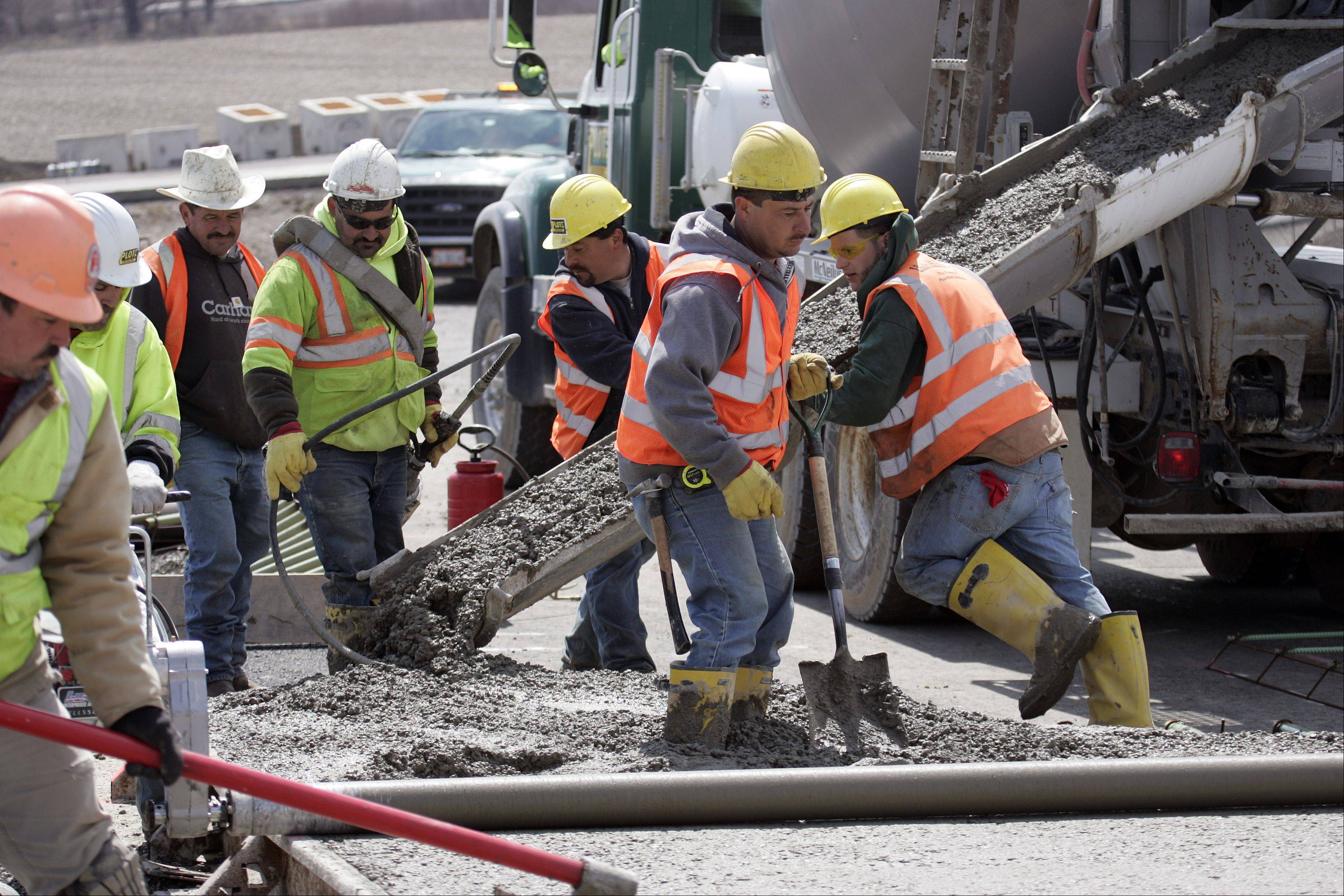 Workers pour concrete on the new eastbound ramp on to the Jane Addams Tollway (I-90) from southbound Route 47 in Huntley. Completion of the full interchange is expected this year.