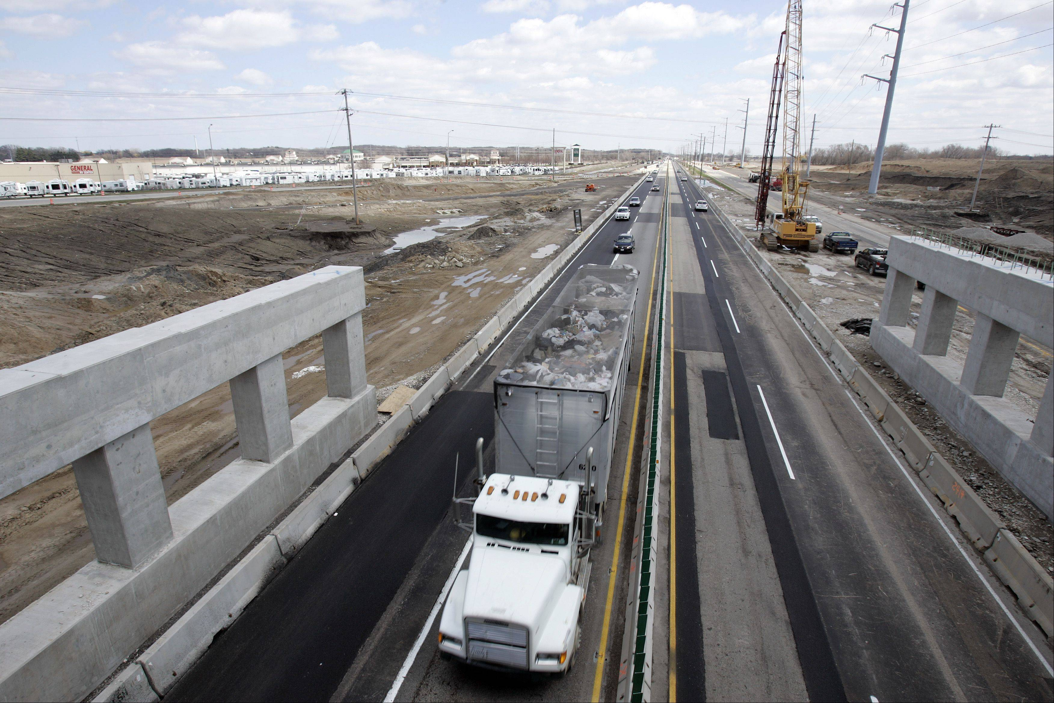The spring/summer construction season is ramping up. A truck travels west along the Jane Addams Tollway (I-90) as construction continues at the new full interchange at Route 47 in Huntley.
