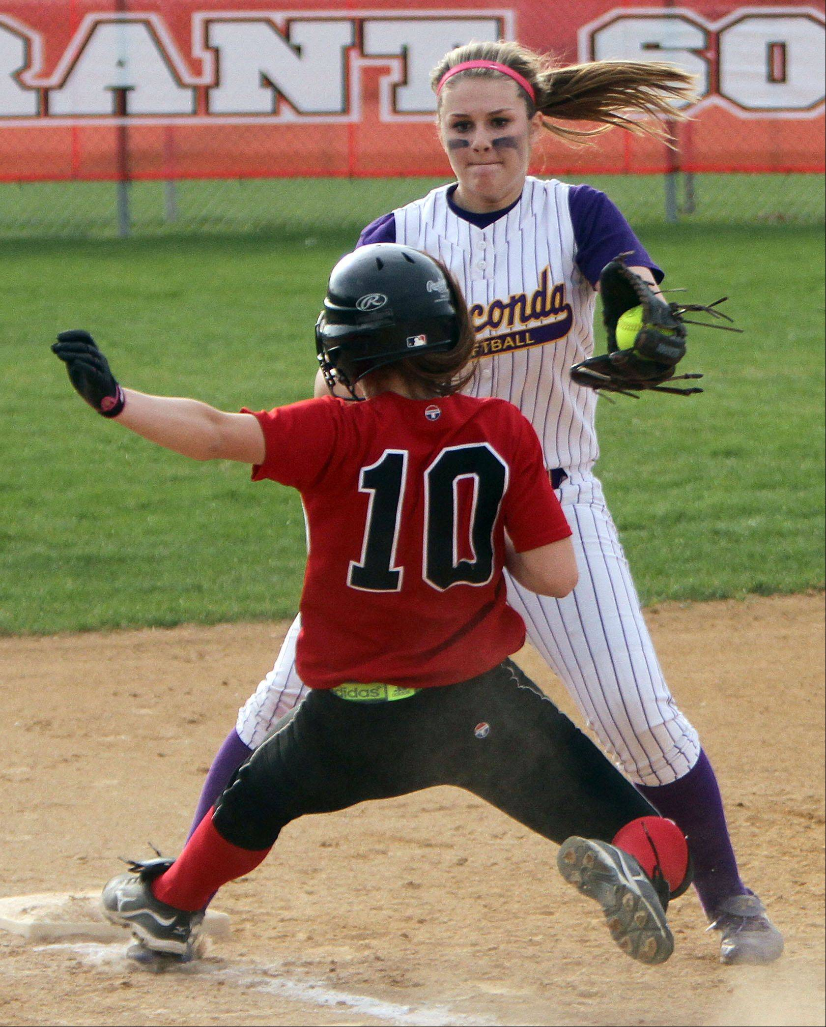 Grant's Bri Dreschler just gets back to third beating the tag by Wauconda's Brooke Sefcik on Monday at Grant.
