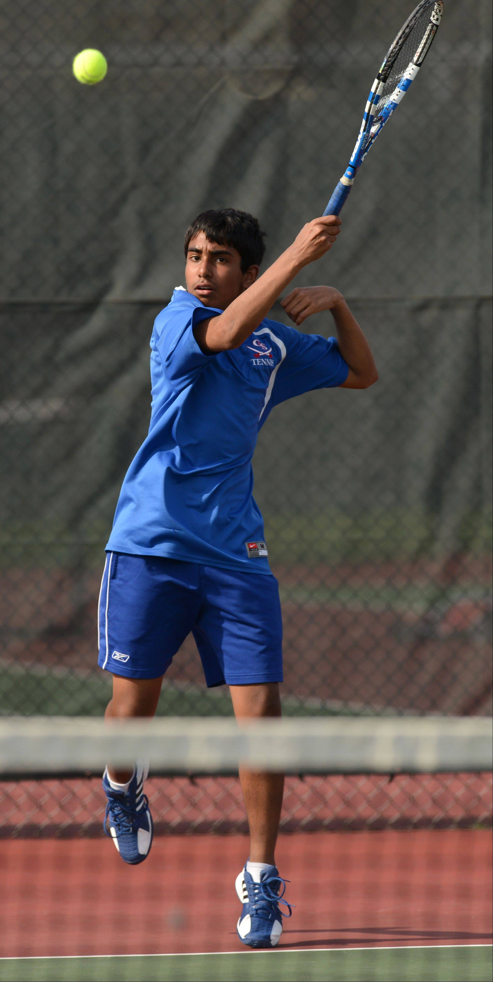 Number 2 singles Avi Panjwani of Glenbard South plays against Camden Knights of Addison Trail during a varsity boys tennis match in Glen Ellyn, Monday.