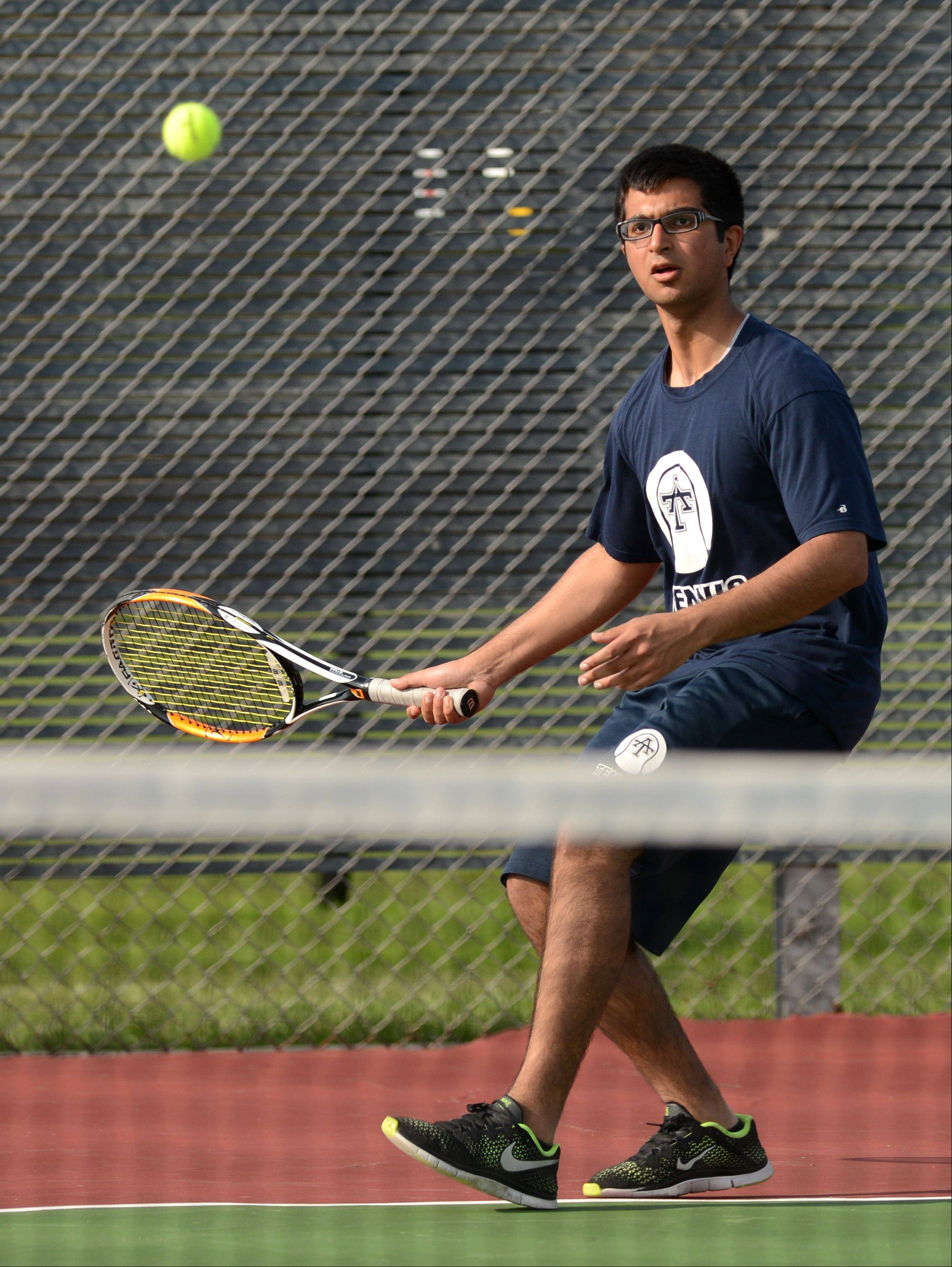 Number 3 singles Forest Beulle of Addison Trail plays against Brandon West of Glenbard South during a varsity boys tennis match in Glen Ellyn, Monday.