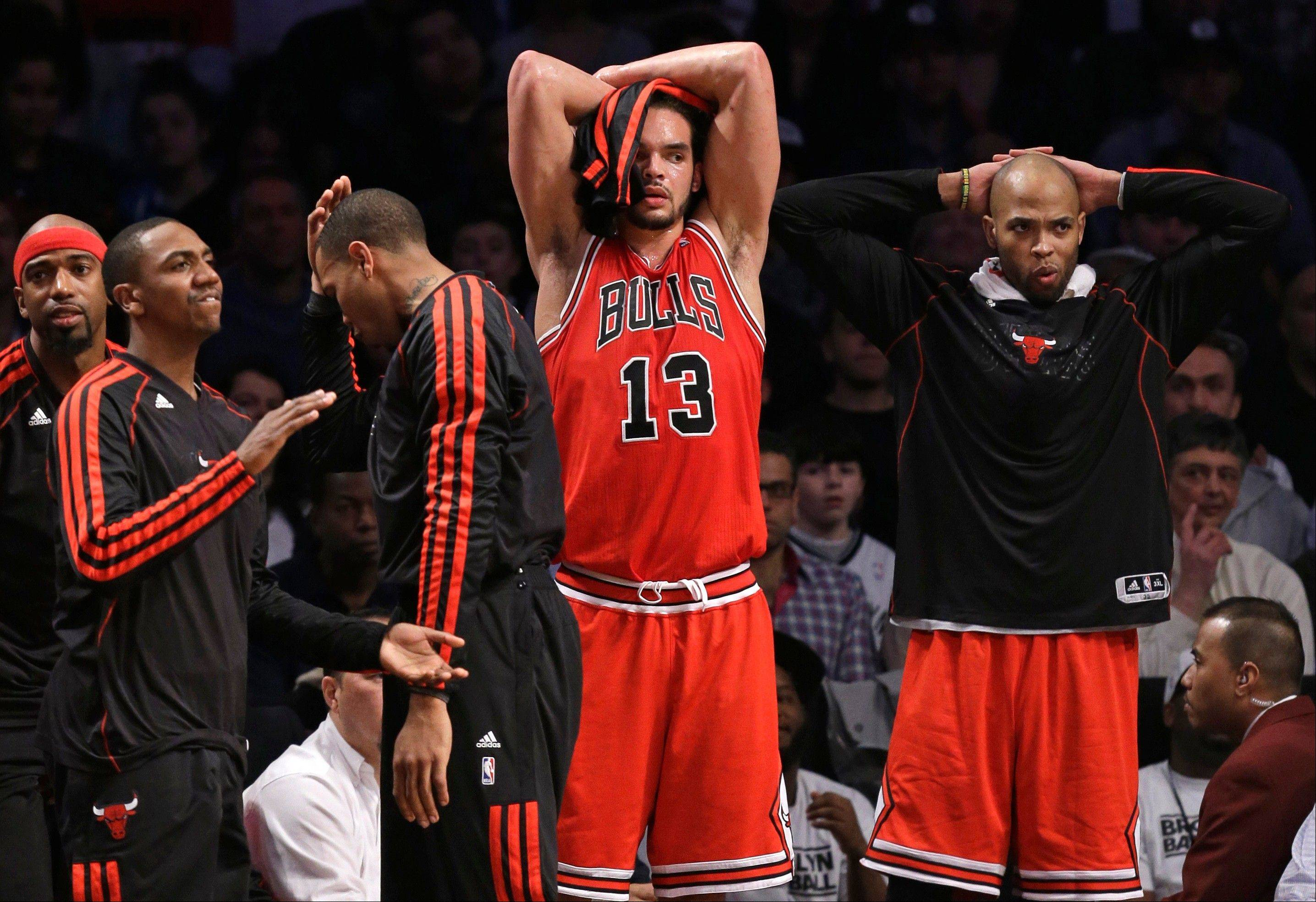 From left, Chicago Bulls' Richard Hamilton, Marquis Teague, Malcolm Thomas, Joakim Noah (13) and Taj Gibson react from the bench in the second half of Game 5 of their first-round NBA basketball playoff series against the Brooklyn Nets, Monday, April 29, 2013, in New York. The Nets won 110-91.