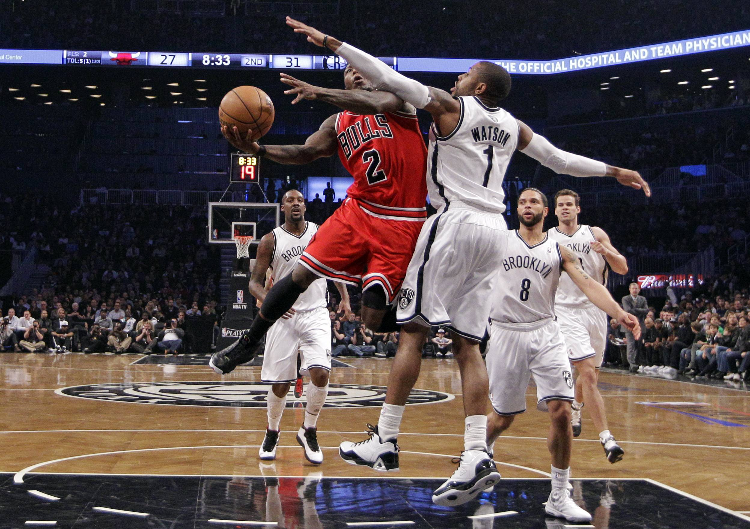 Brooklyn Nets guard C.J. Watson (1) defends as Chicago Bulls guard Nate Robinson (2) goes up for a layup in the second half of Game 5 of their first-round NBA basketball playoff series, Monday, April 29, 2013, in New York. The Nets won 110-91.