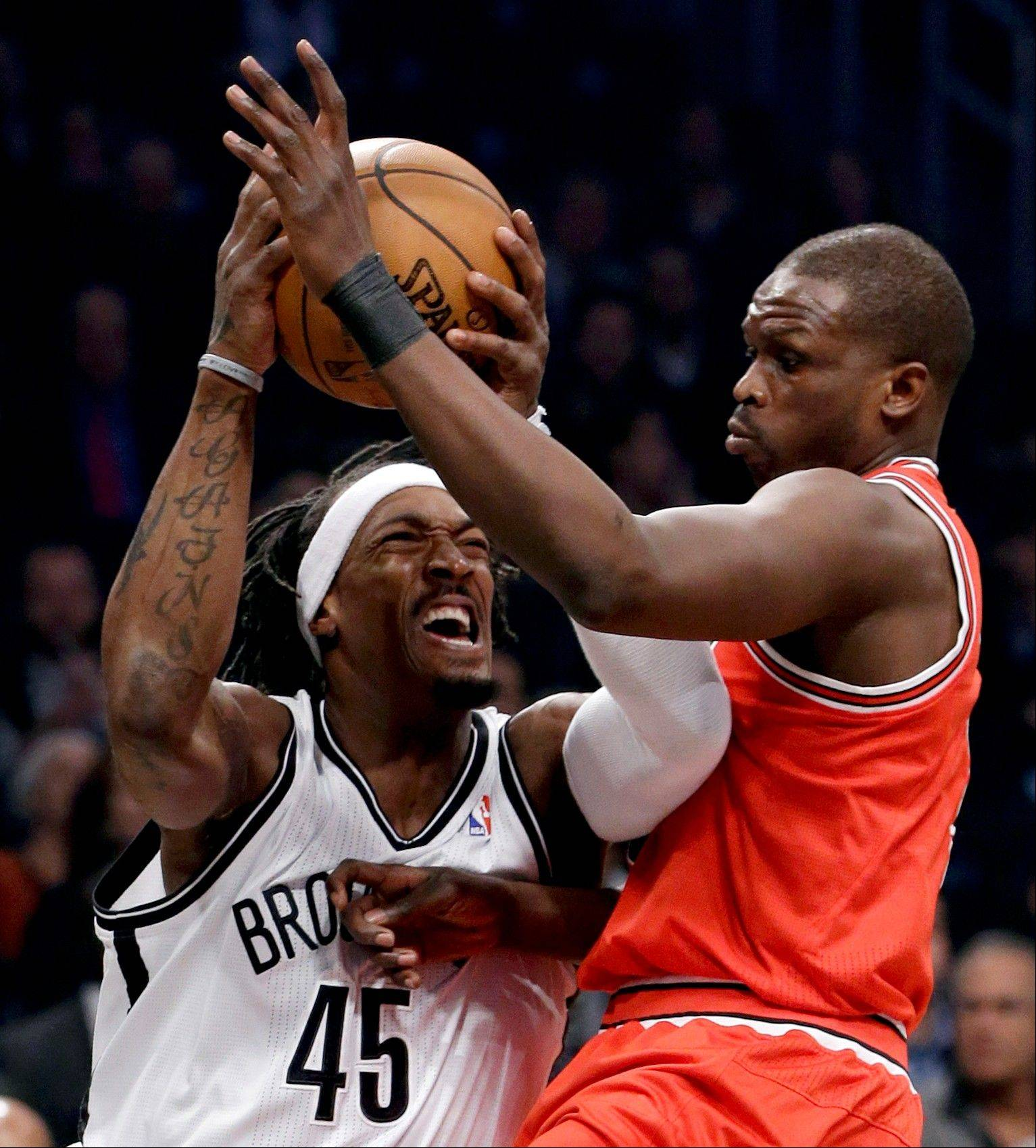 Chicago Bulls forward Luol Deng, right, defends against Brooklyn Nets forward Gerald Wallace (45) in the first half of Game 5 of their first-round NBA basketball playoff series, Monday, April 29, 2013, in New York.