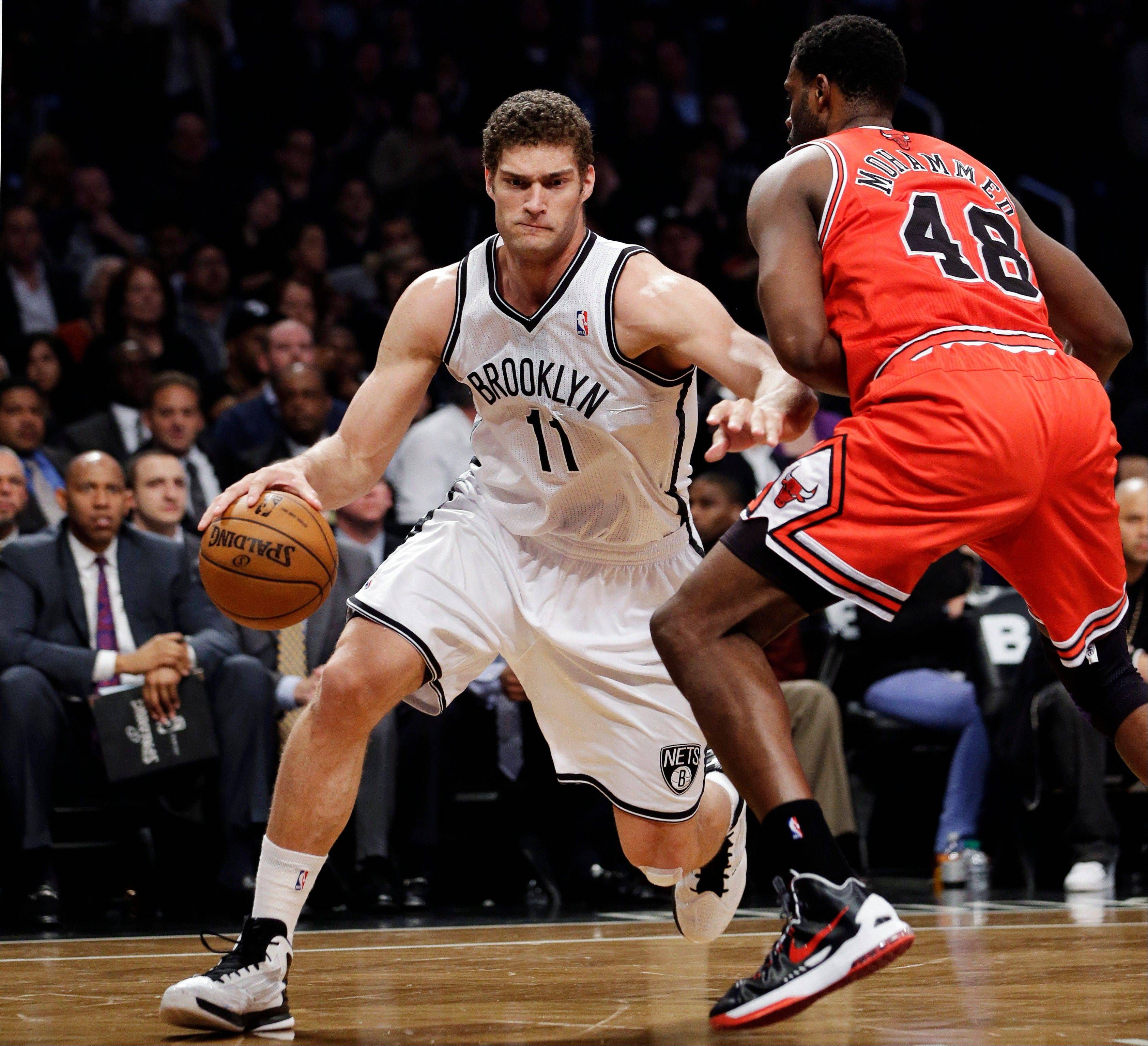 Brooklyn Nets center Brook Lopez (11) drives past Chicago Bulls center Nazr Mohammed (48) in the first half of Game 5 of their first-round NBA basketball playoff series, Monday, April 29, 2013, in New York.