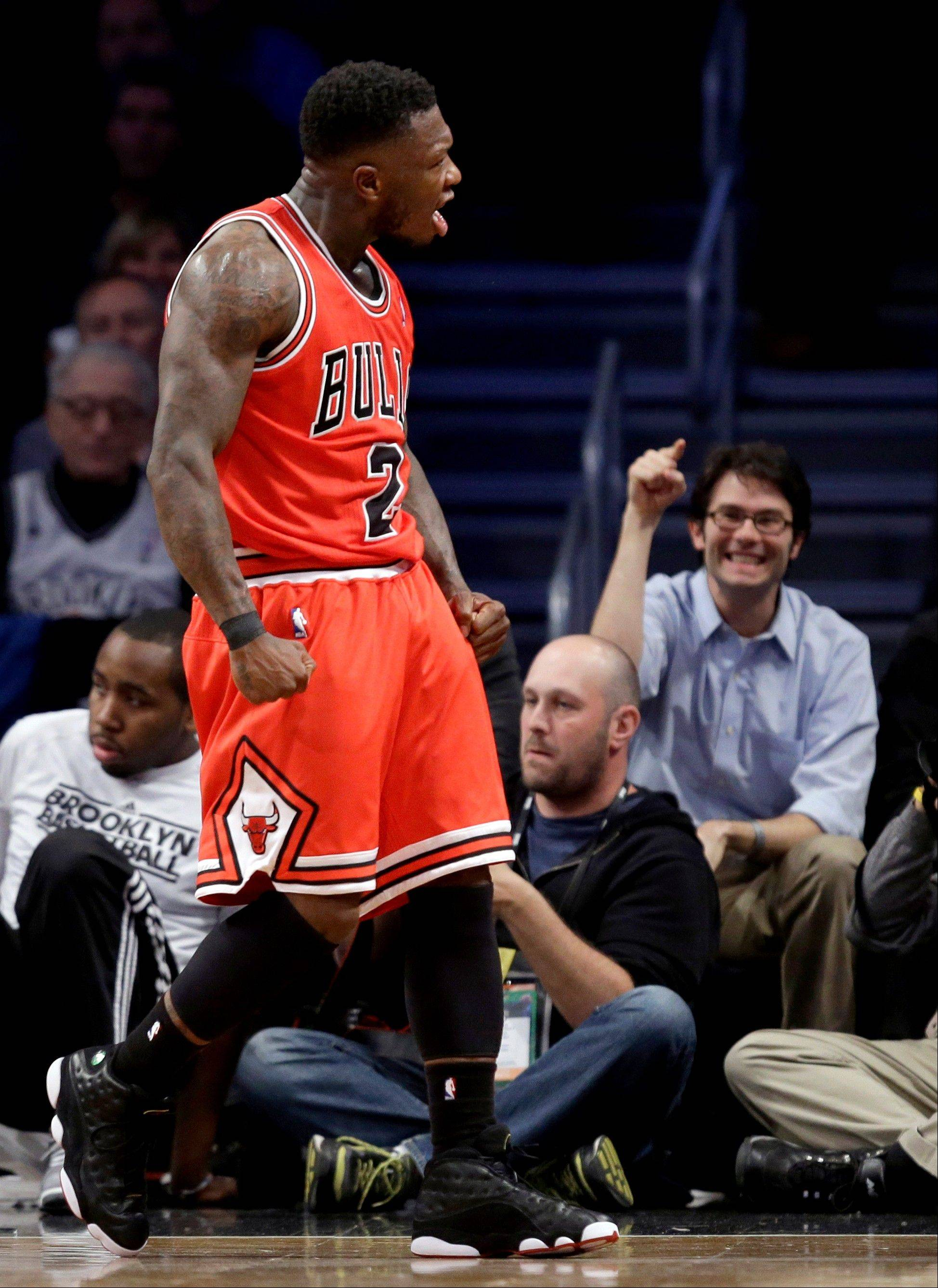 Chicago Bulls guard Nate Robinson (2) reacts after scoring in the first half of Game 5 of their first-round NBA basketball playoff series against the Brooklyn Nets, Monday, April 29, 2013, in New York.