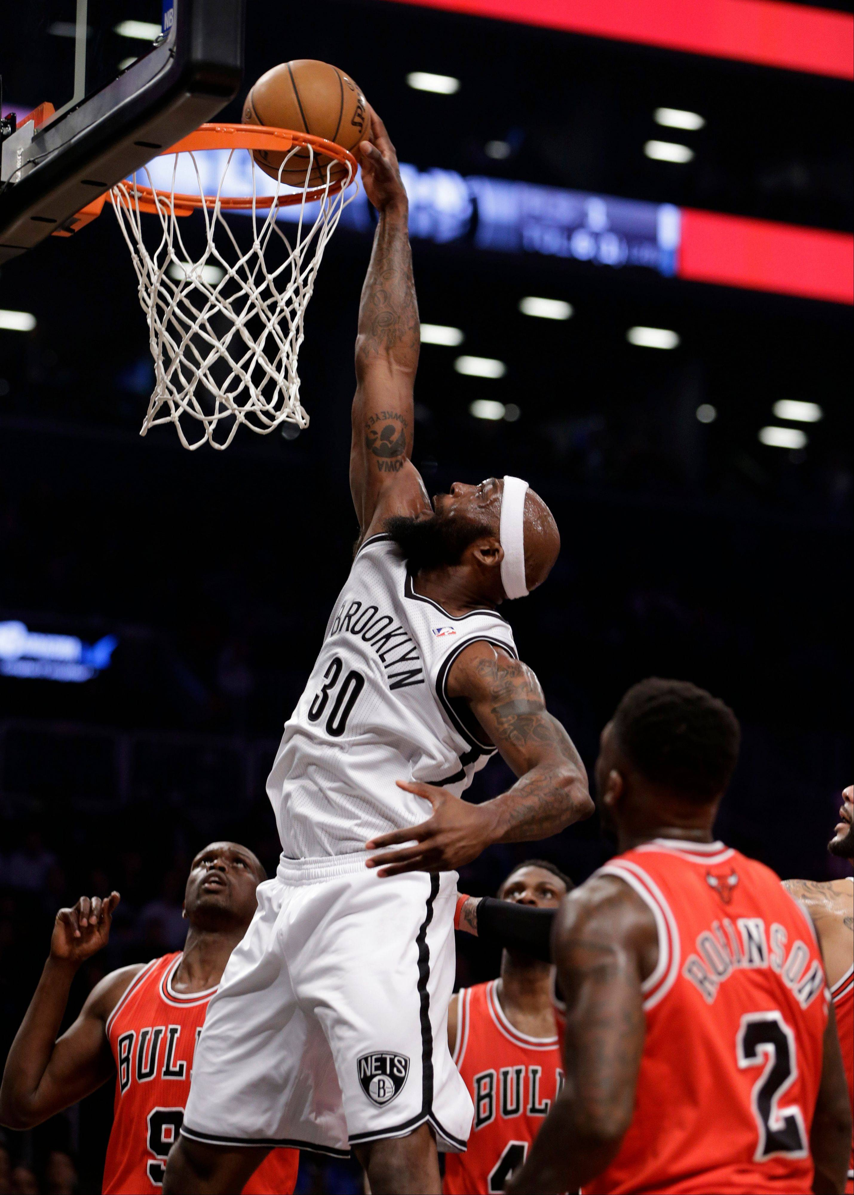 Brooklyn Nets forward Reggie Evans (30) dunks in the first half of Game 5 of their first-round NBA basketball playoff series against the Chicago Bulls, Monday, April 29, 2013, in New York.