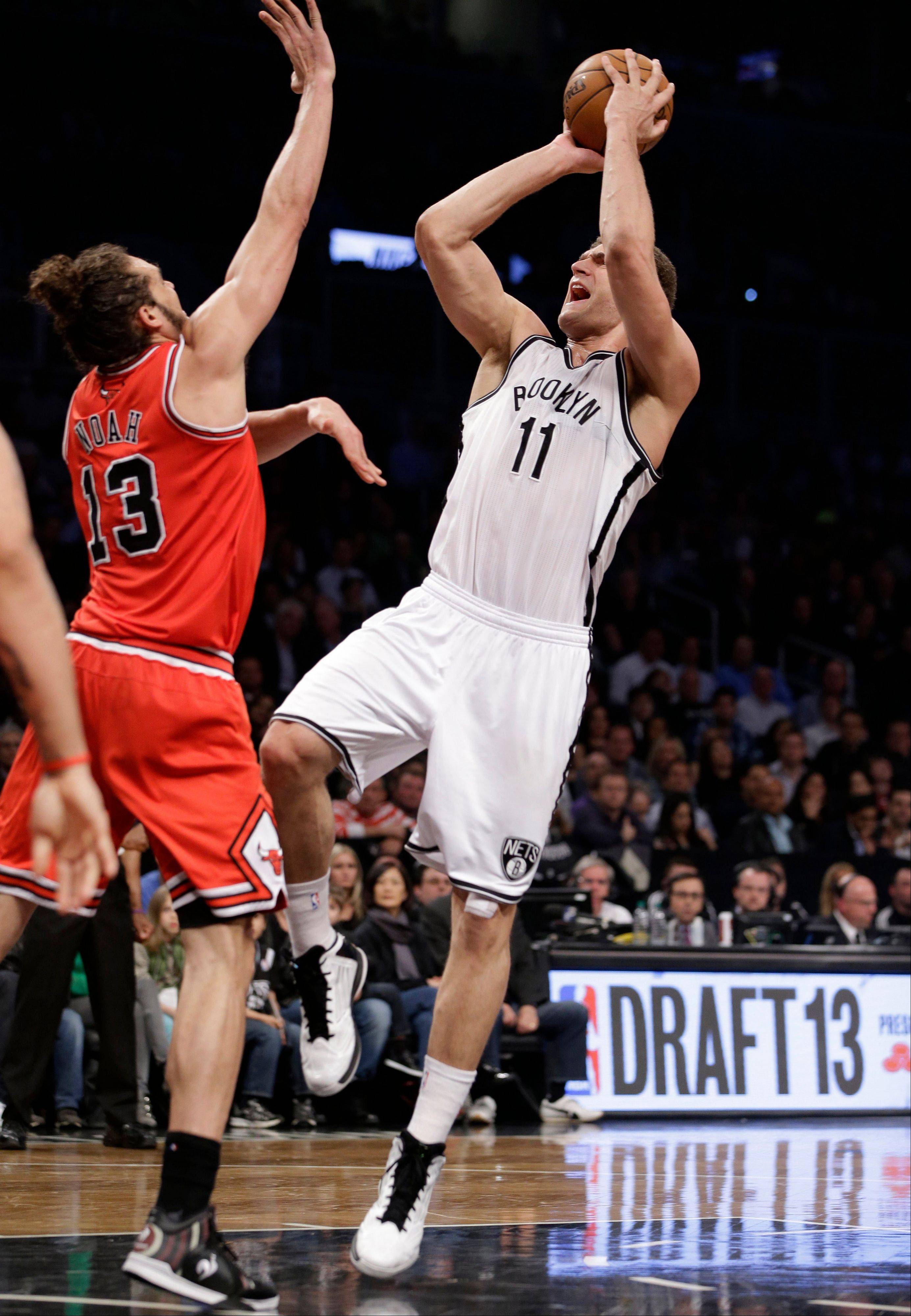 Brooklyn Nets center Brook Lopez (11) shoots over Chicago Bulls center Joakim Noah (13) in the first half of Game 5 of their first-round NBA basketball playoff series, Monday, April 29, 2013, in New York.
