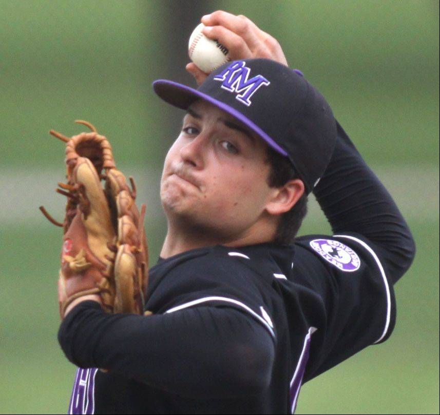 Rolling Meadows' Mickey Wazorick delivers against Elk Grove at South Salk Park in Rolling Meadows on Monday evening.