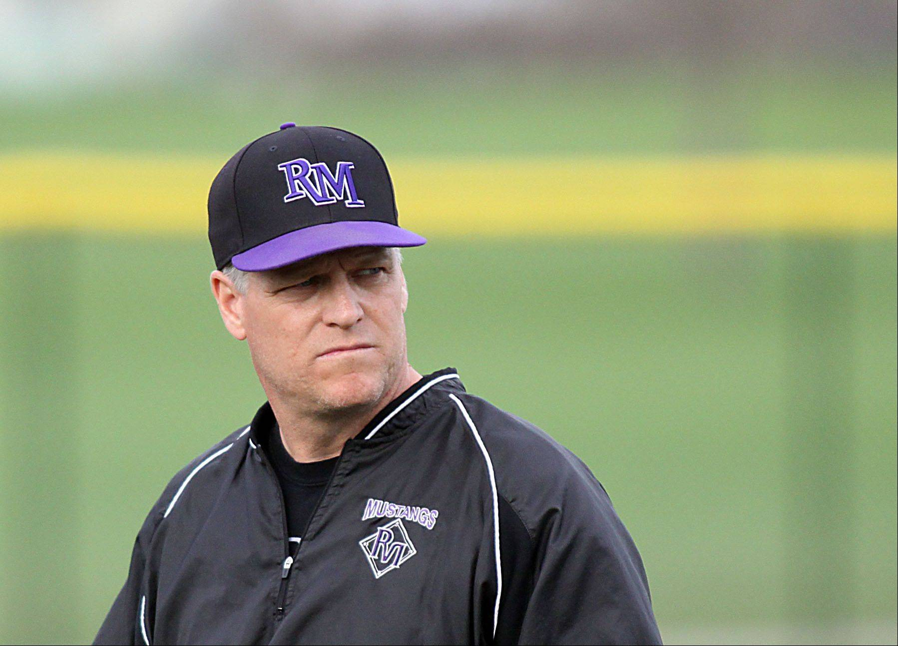 Rolling Meadows coach Jim Lindeman walks back to the dugout during Monday's game with Elk Grove at South Salk Park on Monday evening. Lindeman is a former big-leaguer, having spent parts of nine seasons with, among other teams, the St. Louis Cardinals.