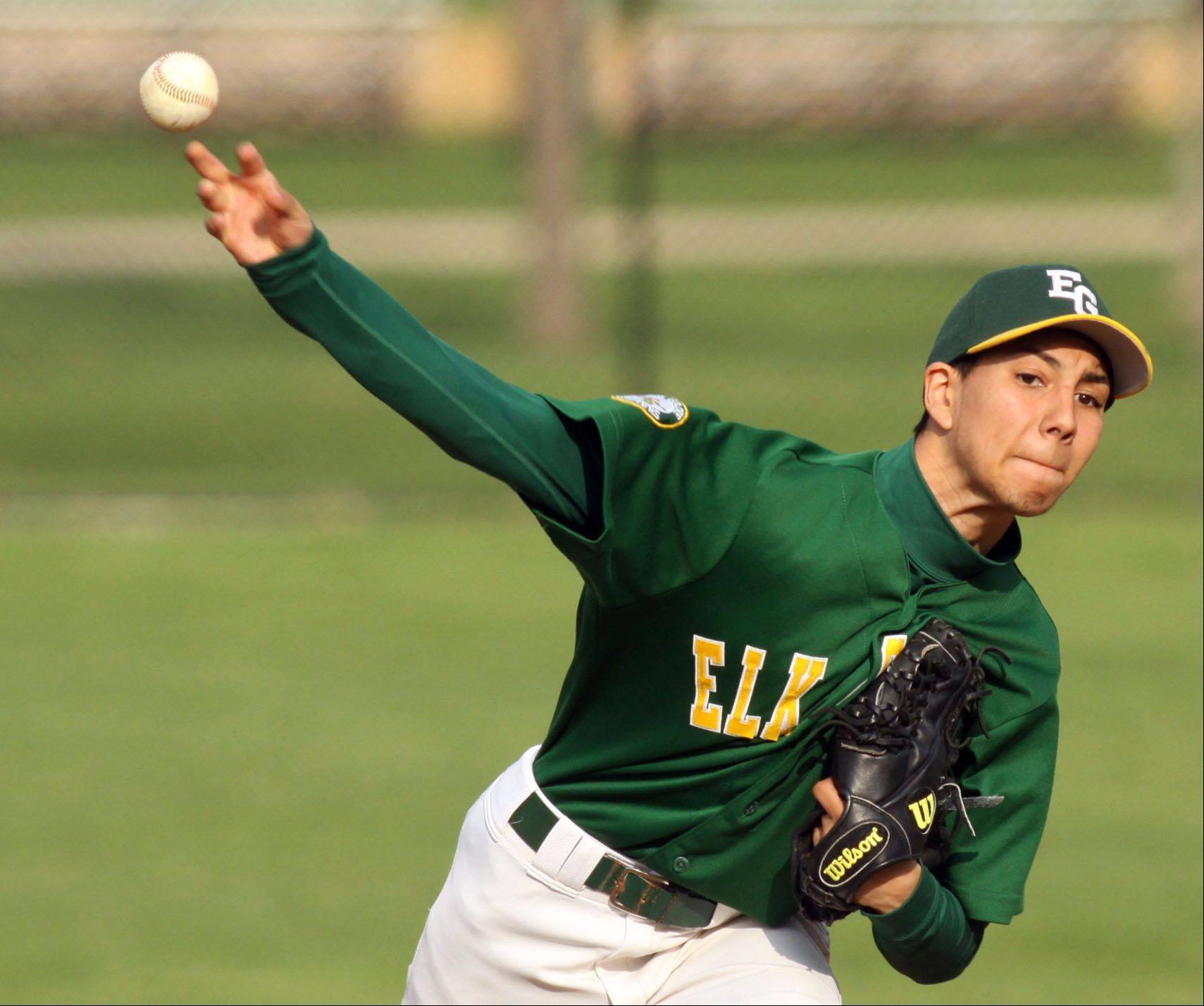 Elk Grove?s David Camacho delivers against Rolling Meadows at South Salk Park in Rolling Meadows on Monday evening.