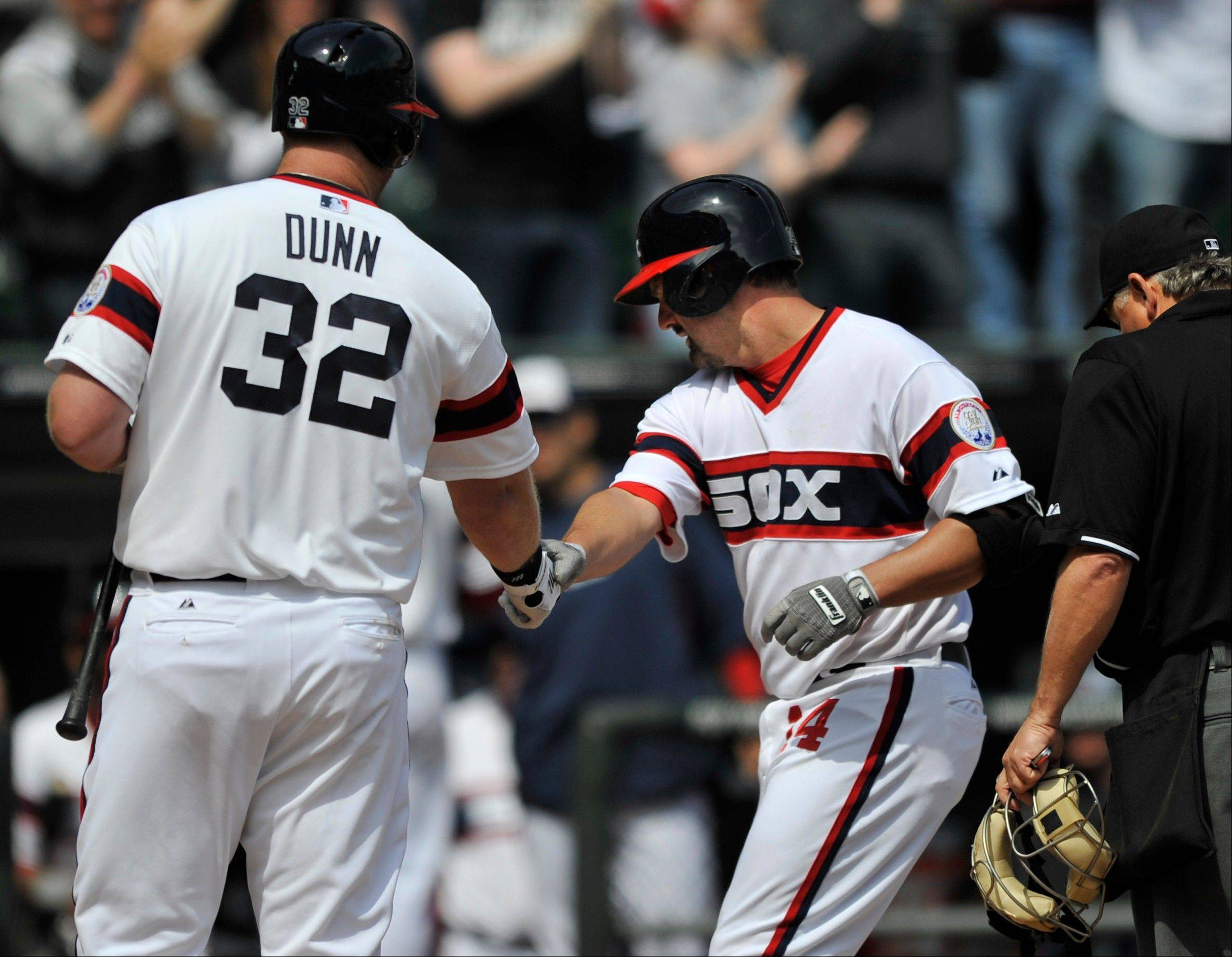Not one to make excuses, Paul Konerko, celebrating with Adam Dunn after hitting a 2-run homer Sunday against Tampa Bay, says the weather has been a factor in the White Sox' slow start offensively.