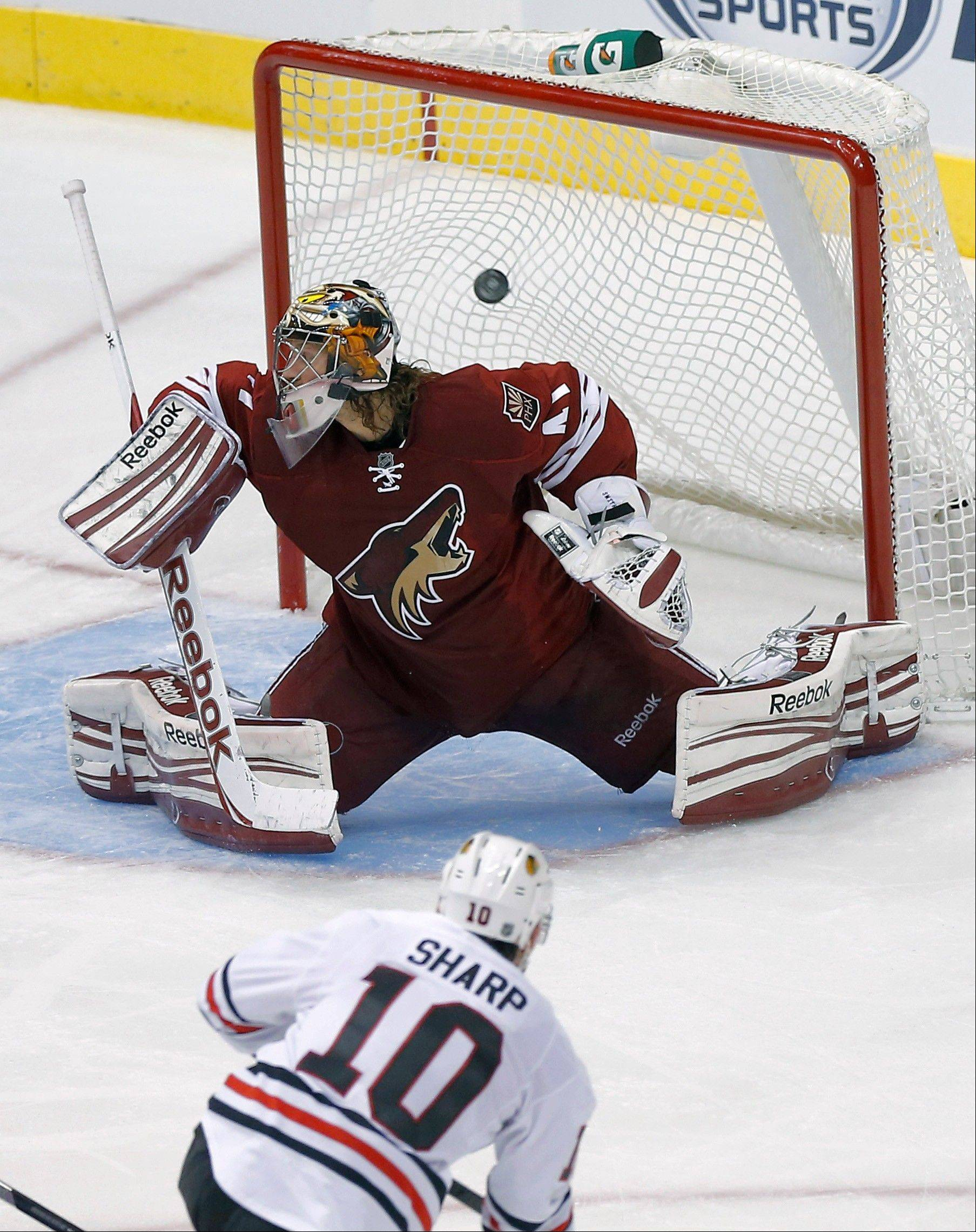 For the second game of the shortened NHL season, Patrick Sharp (10) scored a goal against Phoenix Coyotes goalie Mike Smith in Glendale, Ariz. Phoenix knocked the Hawks out of the 2012 playoffs, but Chicago won this rematch 6-4.