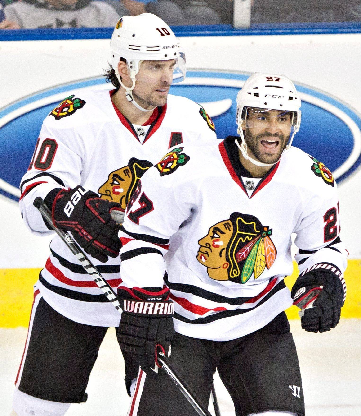 The Hawks clinched the Presidents' Trophy on April 24 when they defeated the Edmonton Oilers. Here Blackhawks' Johnny Oduya and Patrick Sharp celebrate a goal.