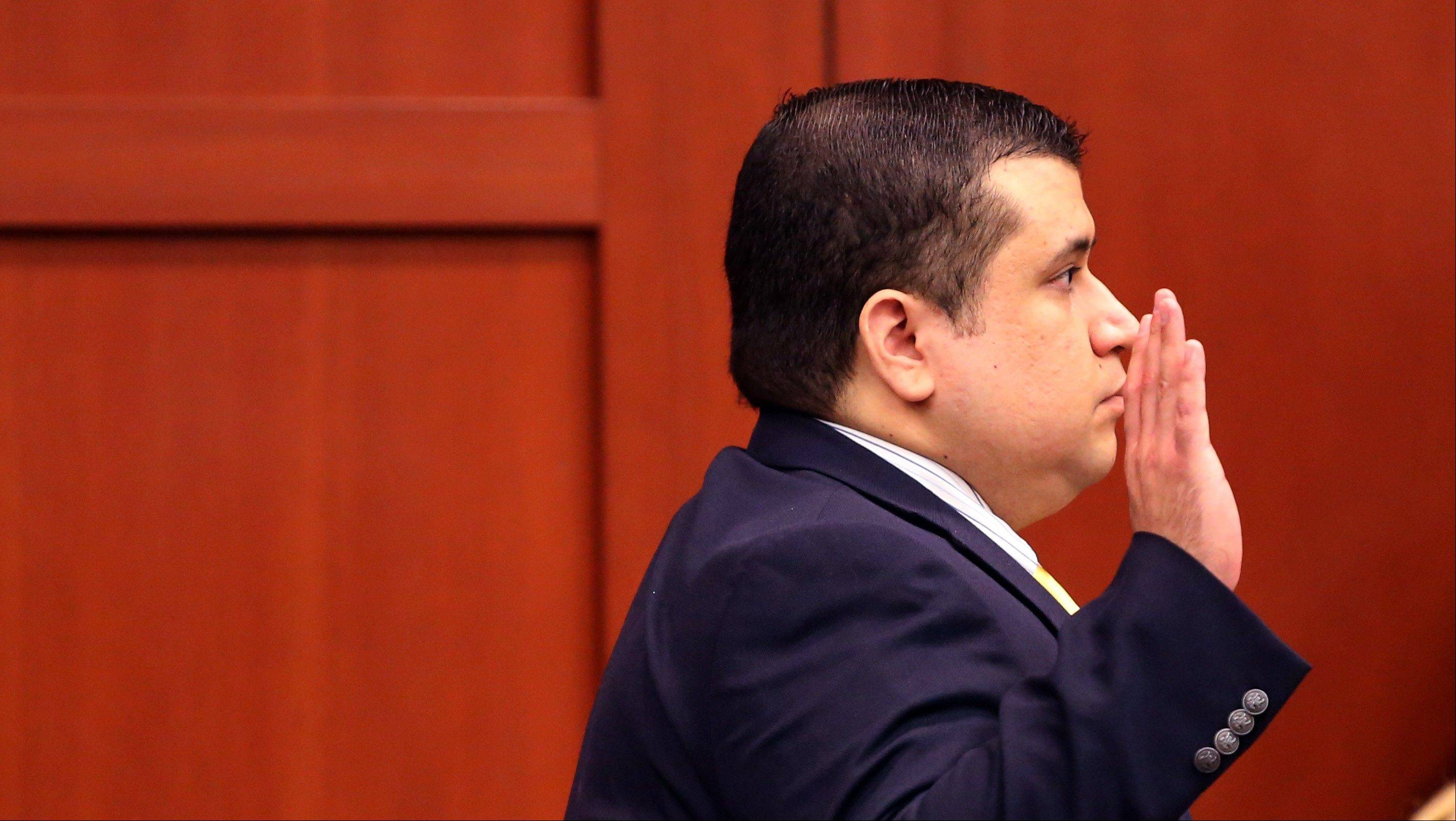 "George Zimmerman, defendant in the killing of Trayvon Martin, is sworn in before answering questions by the judge, in Seminole circuit court, in Sanford, Fla., during a pretrial hearing, Tuesday, April 30, 2013. Zimmerman says he agrees with his attorneys' decision not to seek an immunity hearing under the state's ""Stand Your Ground"" self-defense law."