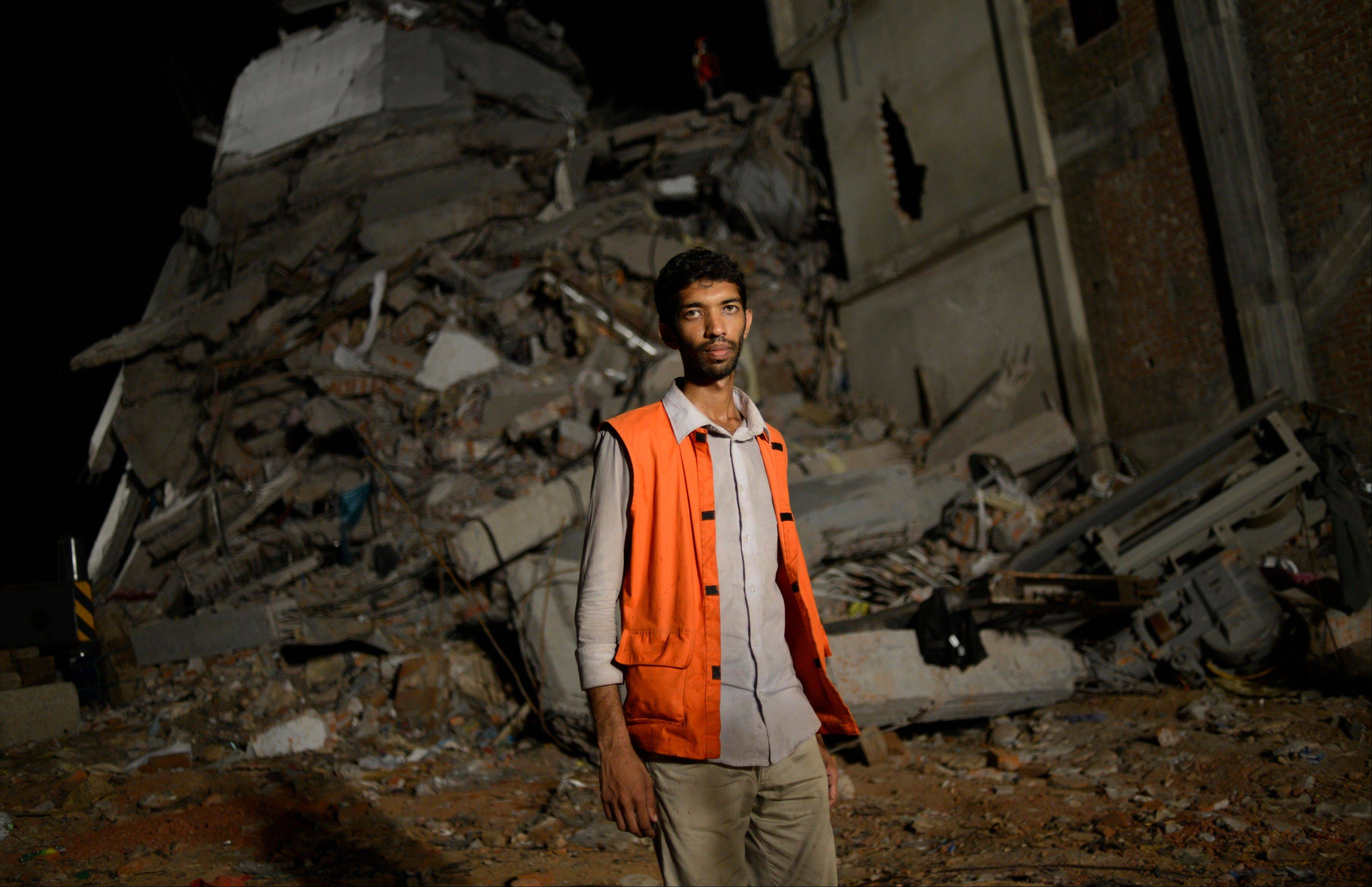 Volunteer Saiful Islam Nasar poses in front of the rubble of a building collapse in Savar, near Dhaka, Bangladesh. Nasar had no training and almost no equipment. He�s a mechanical engineer. Like Nasar, hundreds of volunteers rushed to the site of a building that collapsed last week to rescue thousands of people trapped in the rubble. They were ordinary folk � self-taught medics and neophyte rescuers.
