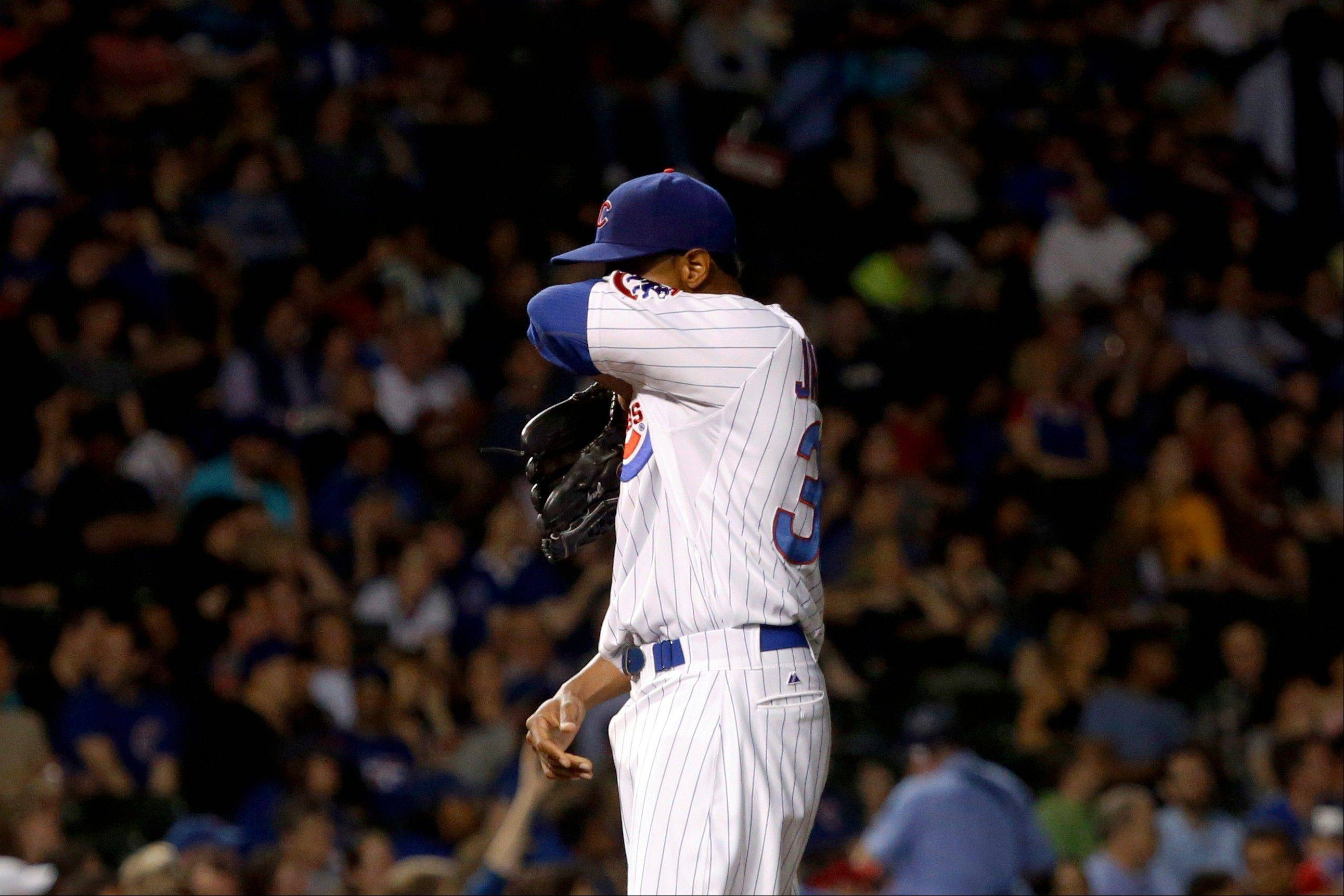 Chicago Cubs starting pitcher Edwin Jackson wipes his face during the fifth inning of a baseball game against the San Diego Padres, Tuesday, April 30, 2013, in Chicago. (AP Photo/Charles Rex Arbogast)