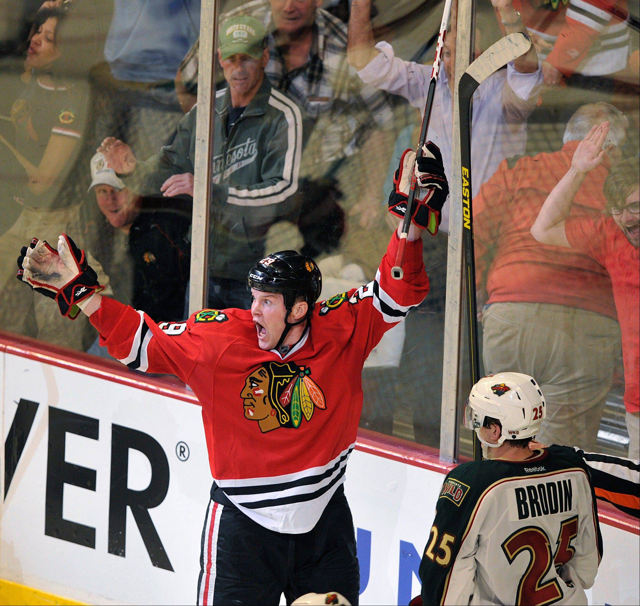 The Blackhawks' Bryan Bickell celebrates after scoring the game-winning goal in overtime of Game 1 against the Minnesota Wild on Tuesday at the United Center.