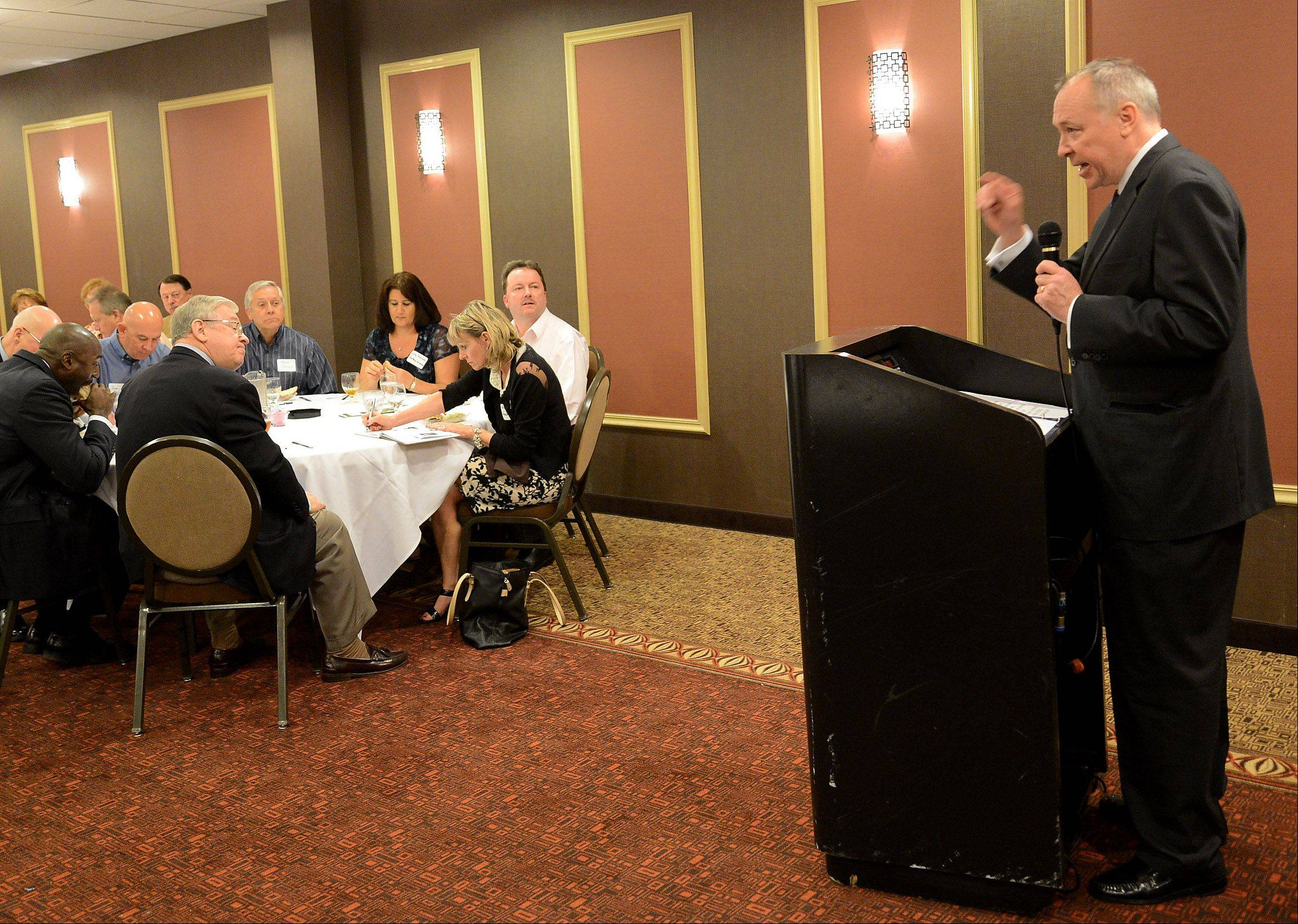 Cook County Board Commissioner Gregg Goslin speaks at a multi-chamber luncheon in Palatine on Tuesday.