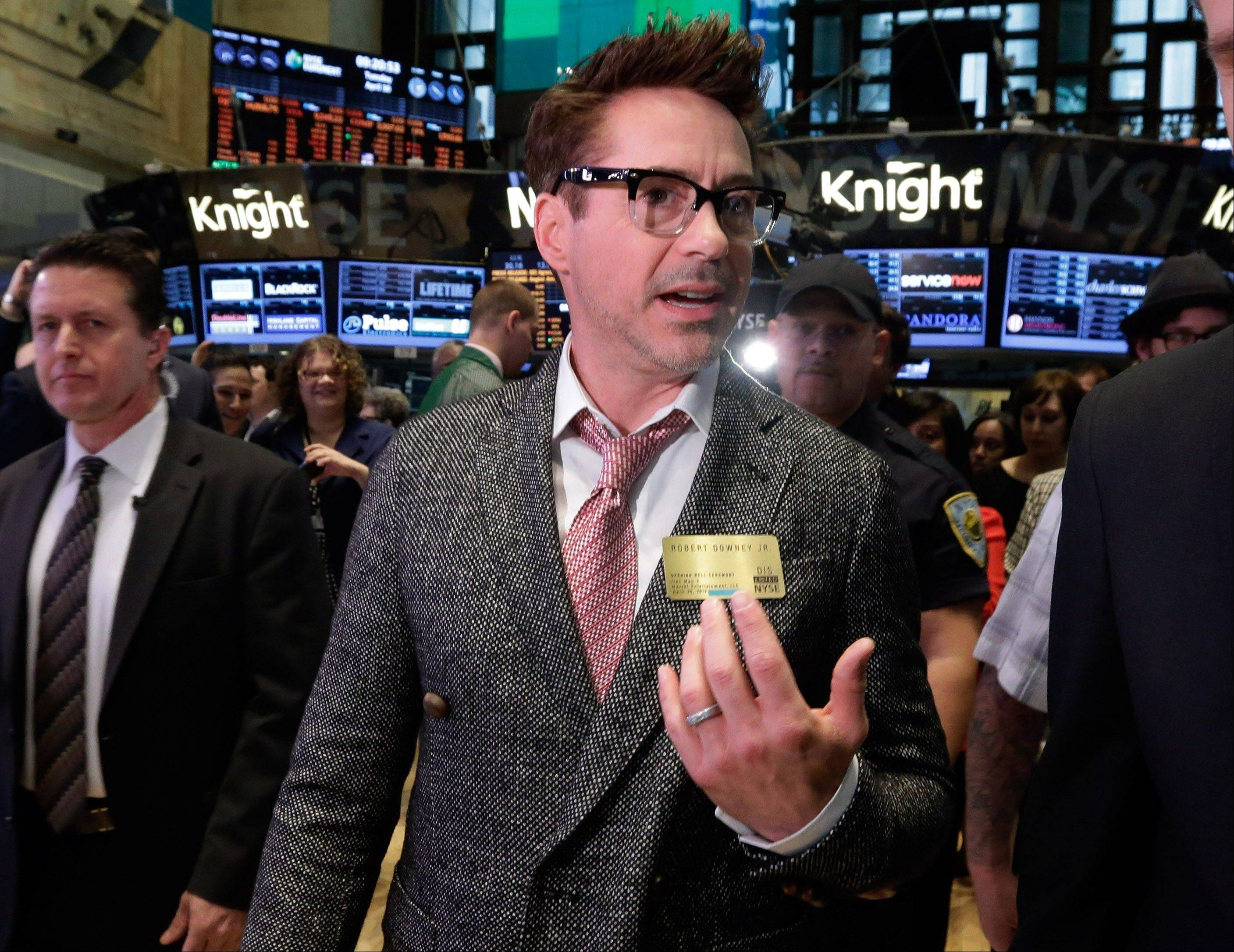 "ASSOCIATED PRESSActor Robert Downey Jr. visits the trading floor of the New York Stock Exchange before ringing the opening bell, Tuesday. Downey's film, ""Iron Man 3,"" also starring Don Cheadle and Gwyneth Paltrow, opens nationwide on May 3."