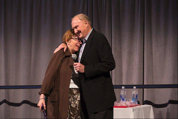 Michael J. Birck co-founder of Tellabs Inc. was feted on Sunday at a reception with about 400 guests at the company's headquarters in Naperville. Here, he hugs his wife, Kay, before he officially retires as chairman of the board on Wednesday during the company's annual shareholder meeting.