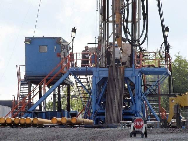 A crew works on a gas drilling rig at a well site for shale-based natural gas in Zelienople, Pa. The fracking method used is a high-pressure mixture of water, sand and chemicals to crack and hold open thick rock formations, releasing trapped oil and gas.