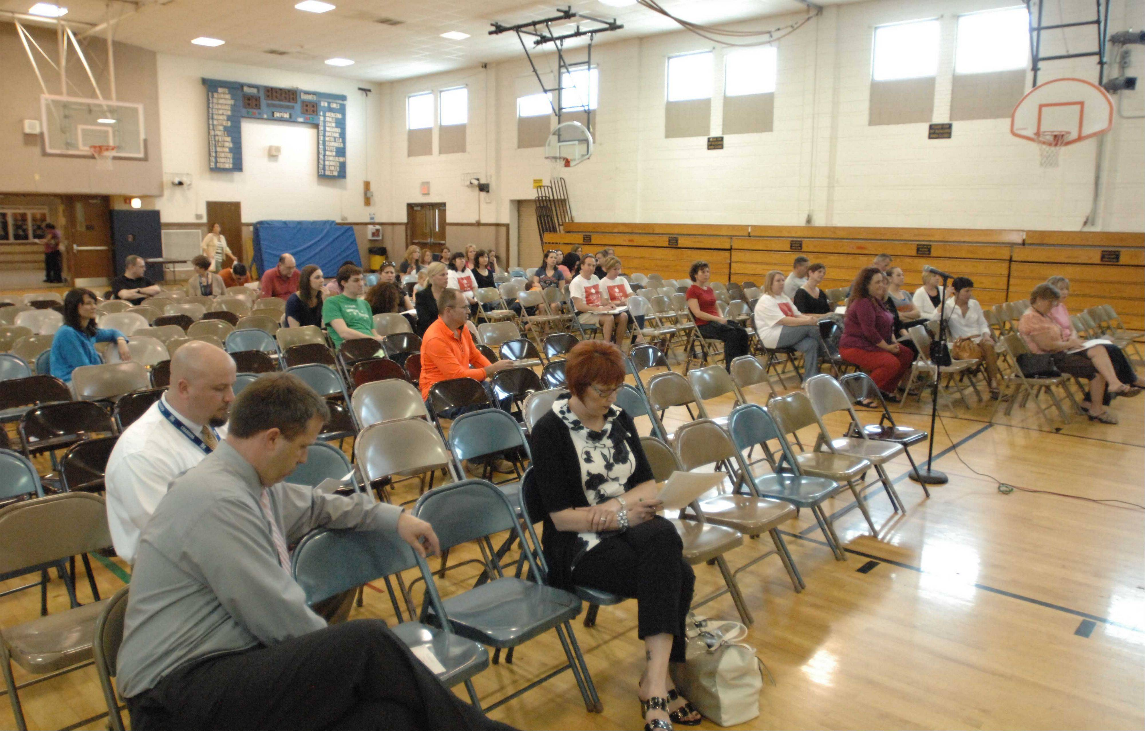 About 60 people attended the Itasca Elementary District 10 school board meeting, where board members decided to reverse some cuts that were made after voters rejected a proposed tax hike. Parents say they want all eliminated programs to be restored.