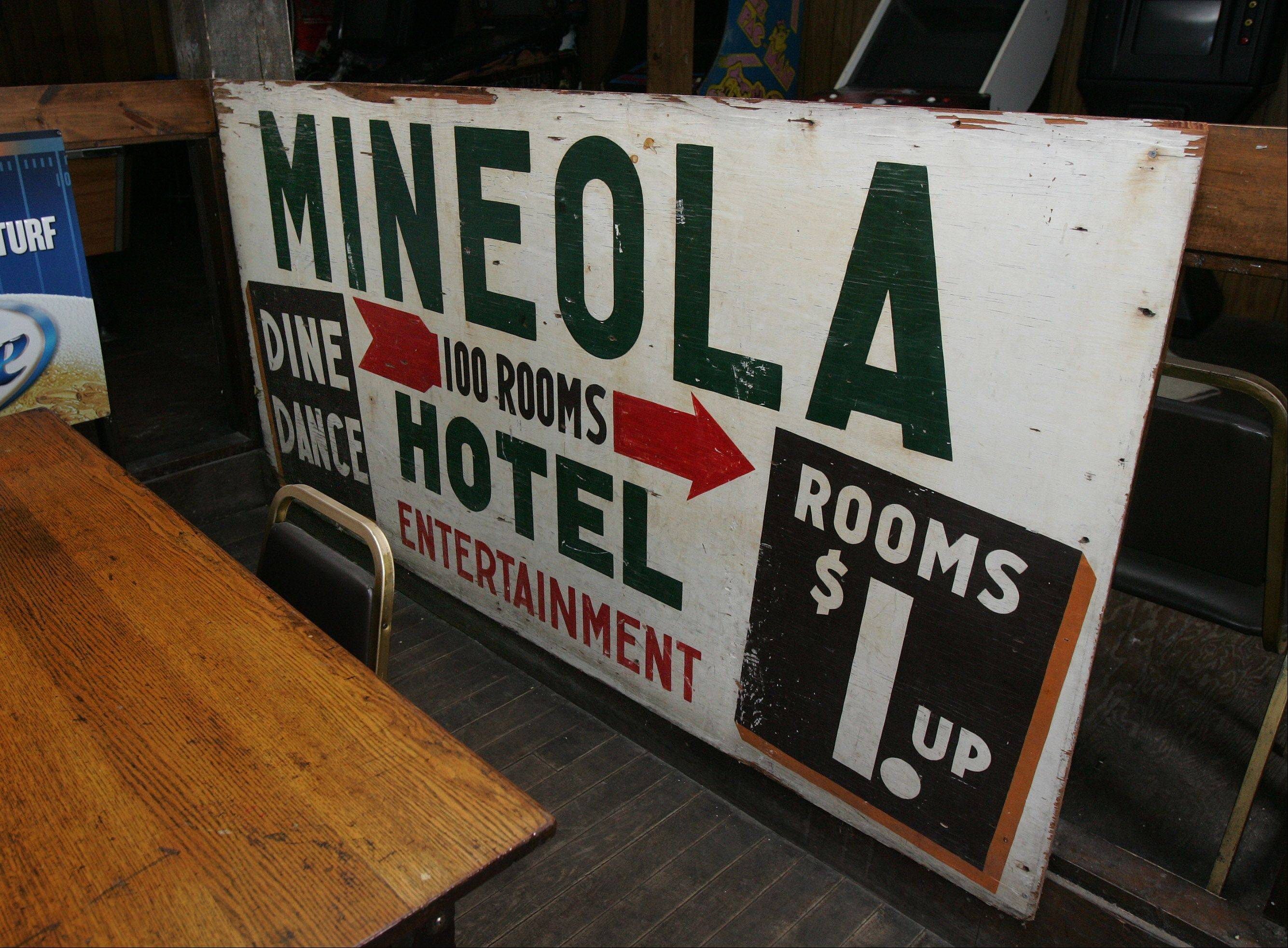 An antique sign showing room rates at the Mineola Hotel in Fox Lake was on display in the lounge. Built in 1894, the shuttered Mineola is possibly the largest wood-frame building in the state, according to Landmarks Illinois.