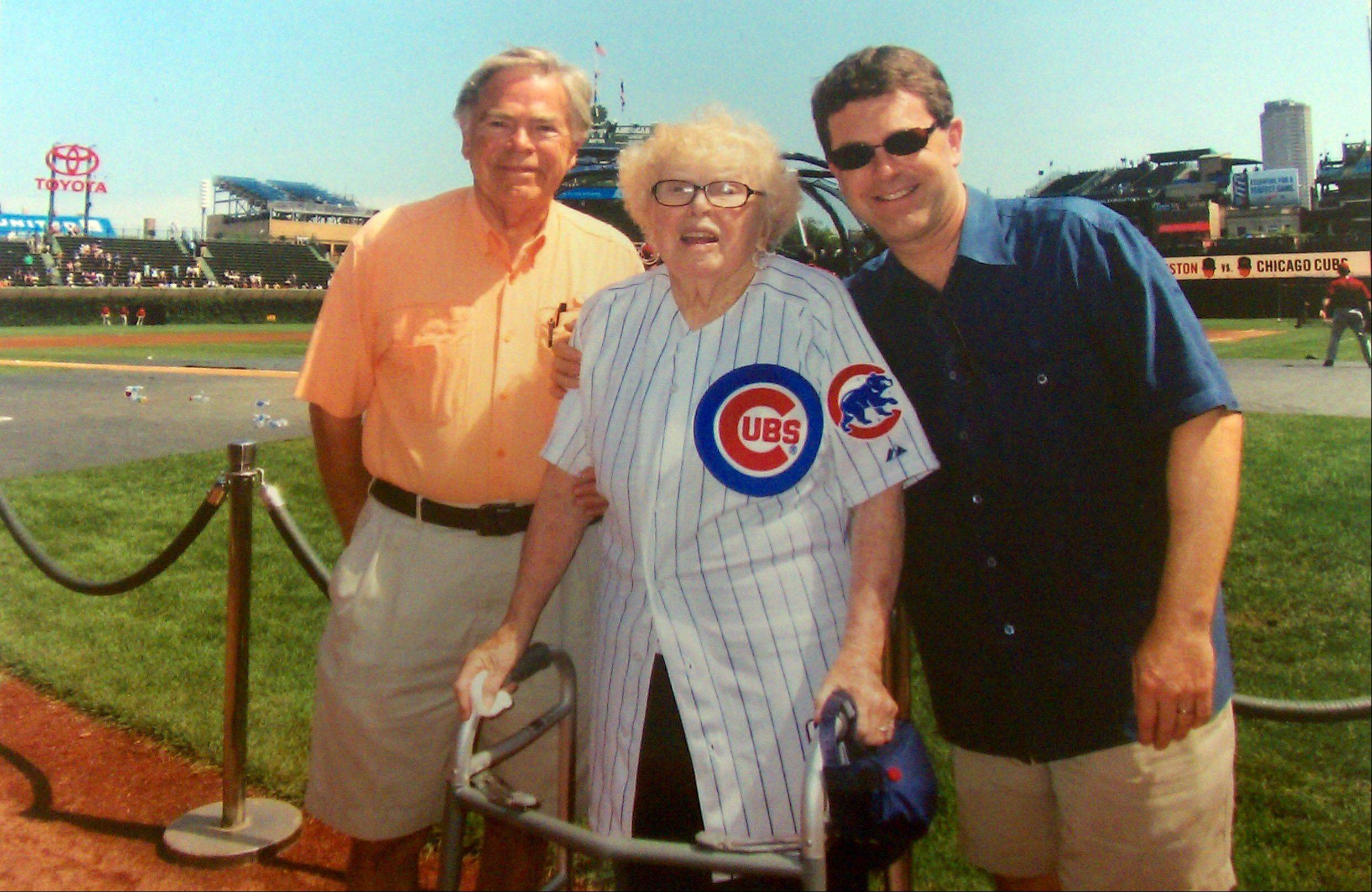 Alice Lundstrom spent her 106th birthday at Wrigley Field with her son, Carl, and her grandson, Brett. The Cubs gave her the special jersey she's wearing. It has her name and the number 106 on the back.