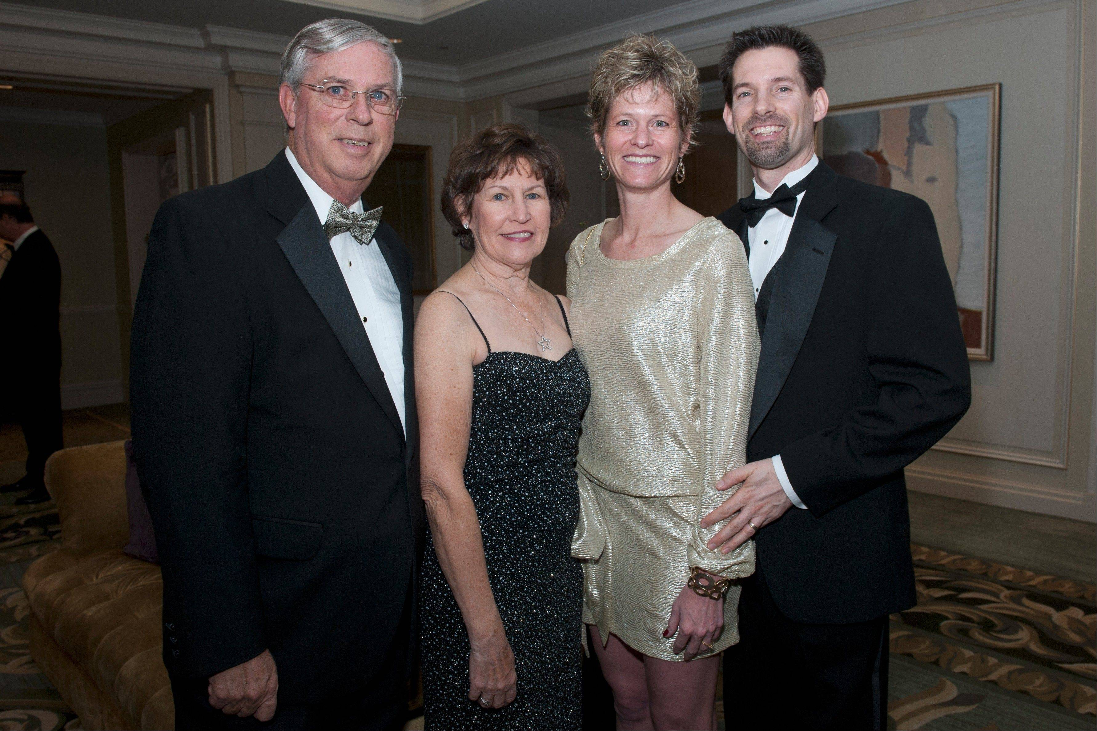 David and Linda Riley of Barrington, on left, and with their son Kevin, far right, and his wife Amy, of Chicago, were among the more than 300 guests to attend the record-breaking Clearbrook Shining Star Ball this weekend. David Riley is a former Clearbrook board chairman, Linda Riley was on he ball's planning committee this year and Kevin Riley is on the organization's associate board.