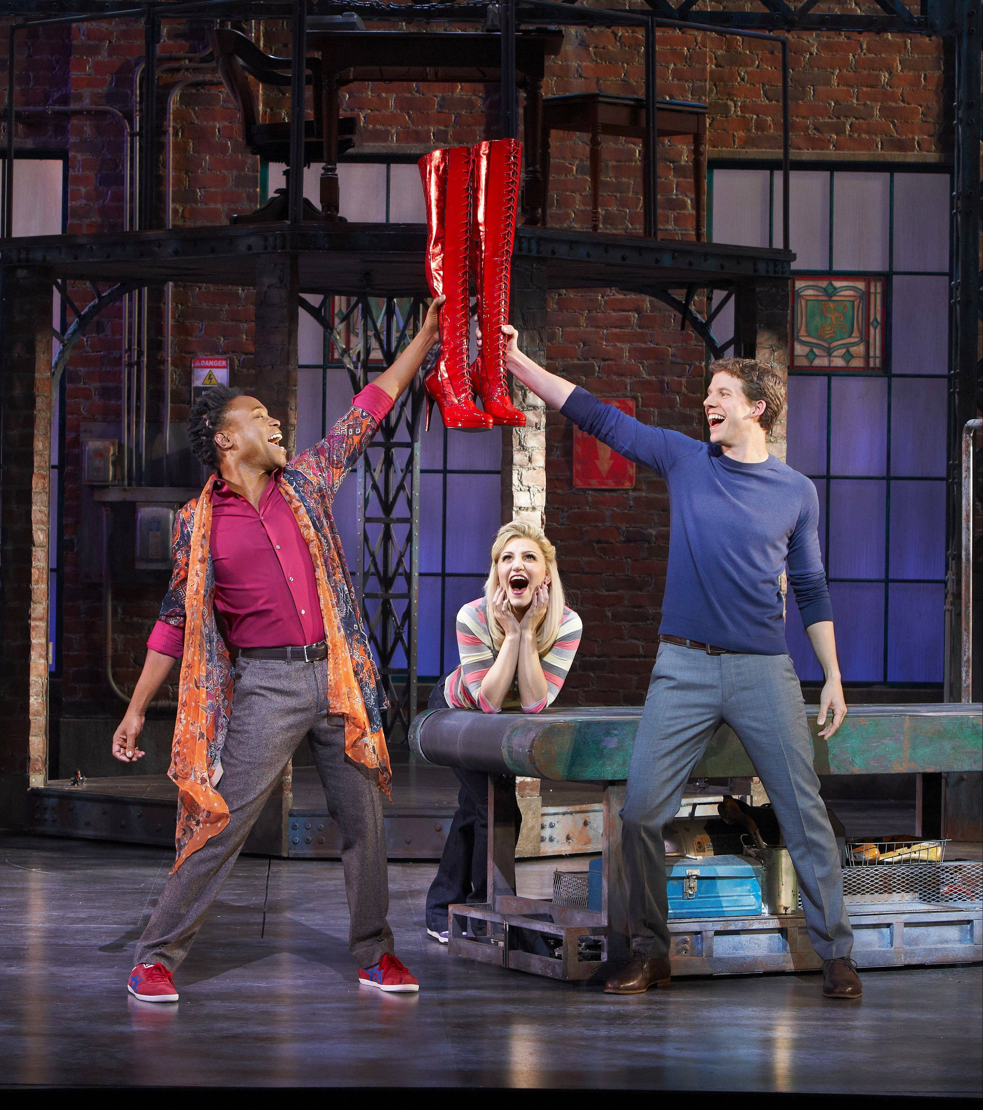 "Lola (Billy Porter, left), Lauren (Annaleigh Ashford) and Charlie (Stark Sands, right) celebrate the first production of ""Kinky Boots"" during the musical's pre-Broadway tryout in Chicago. All three received 2013 Tony Award acting nominations for the production which led all others with 13 nominations."