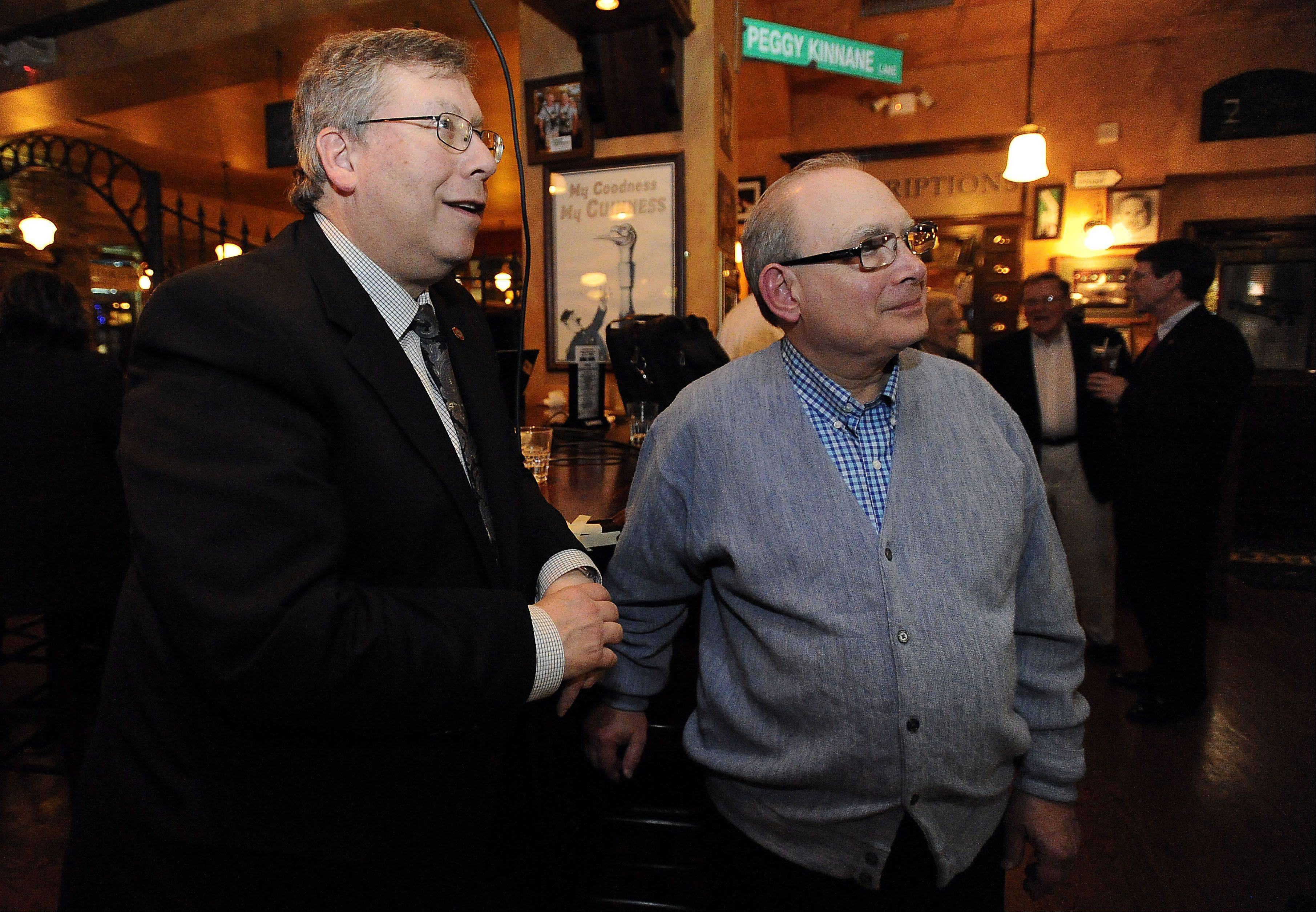 Bert Rosenberg, left, and Norm Breyer watch the polls late into the evening on April 9.