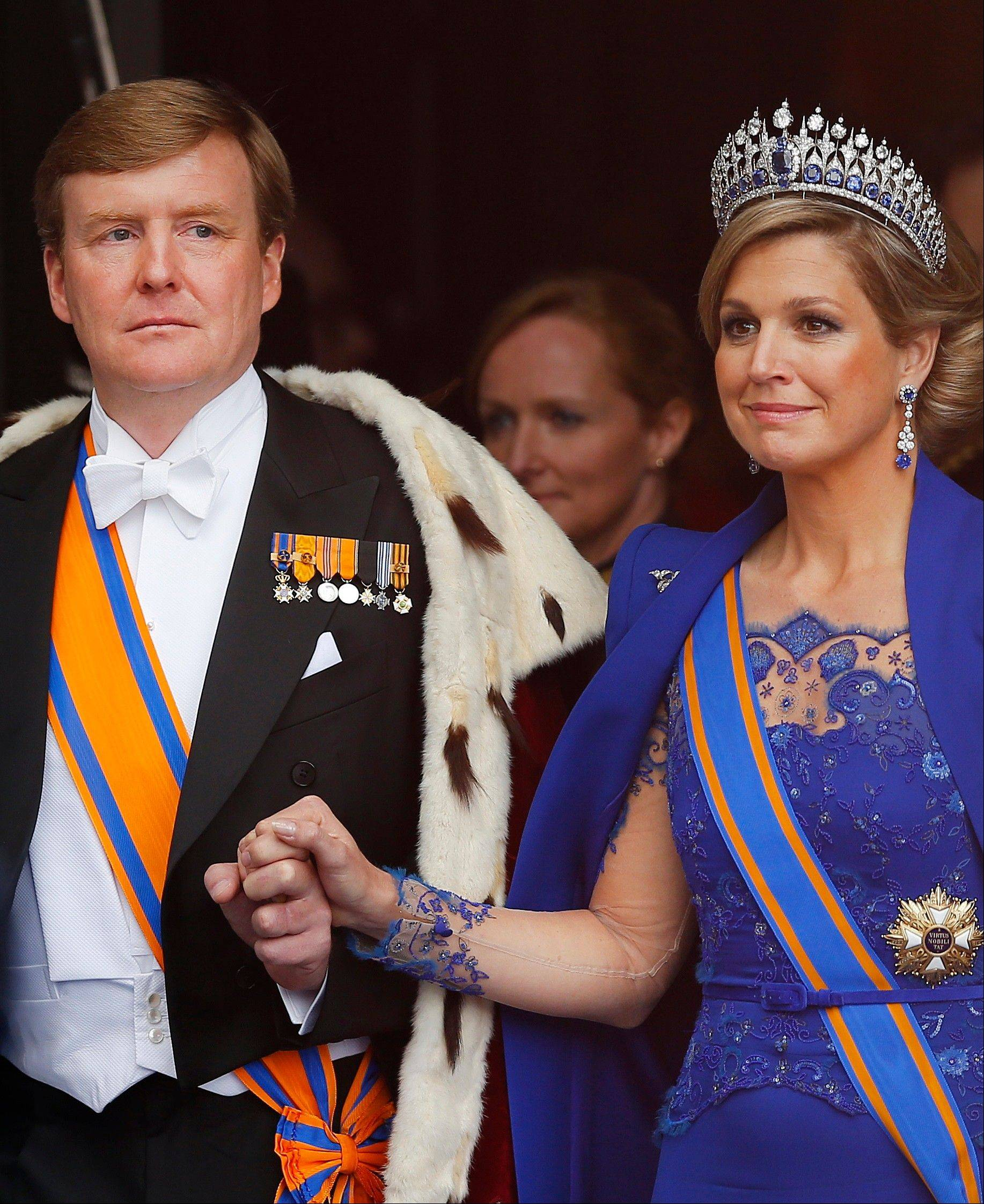 Dutch King Willem-Alexander and his wife Queen Maxima leave the Nieuwe Kerk or New Church in Amsterdam, The Netherlands, after his inauguration Tuesday April 30, 2013. Around a million people are expected to descend on the Dutch capital for a huge street party to celebrate the first new Dutch monarch in 33 years.