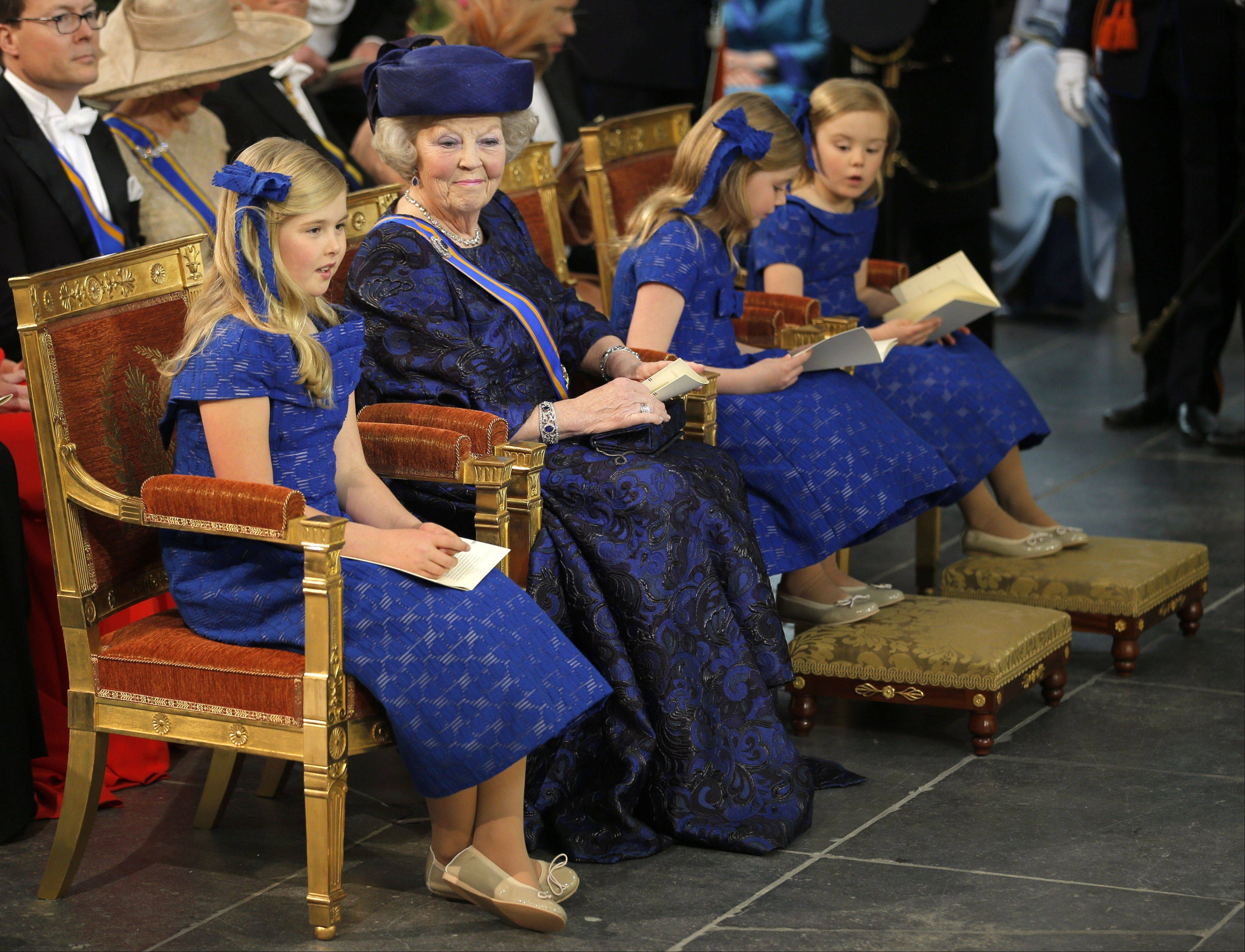 Dutch Princess Beatrix, center left, is joined by the children of Dutch King Willem-Alexander and his wife Queen Maxima, from left: Catharina-Amalia, Alexia and Ariane at the Nieuwe Kerk or New Church in Amsterdam, The Netherlands, prior to the inauguration of King Willem-Alexander, Tuesday April 30, 2013.