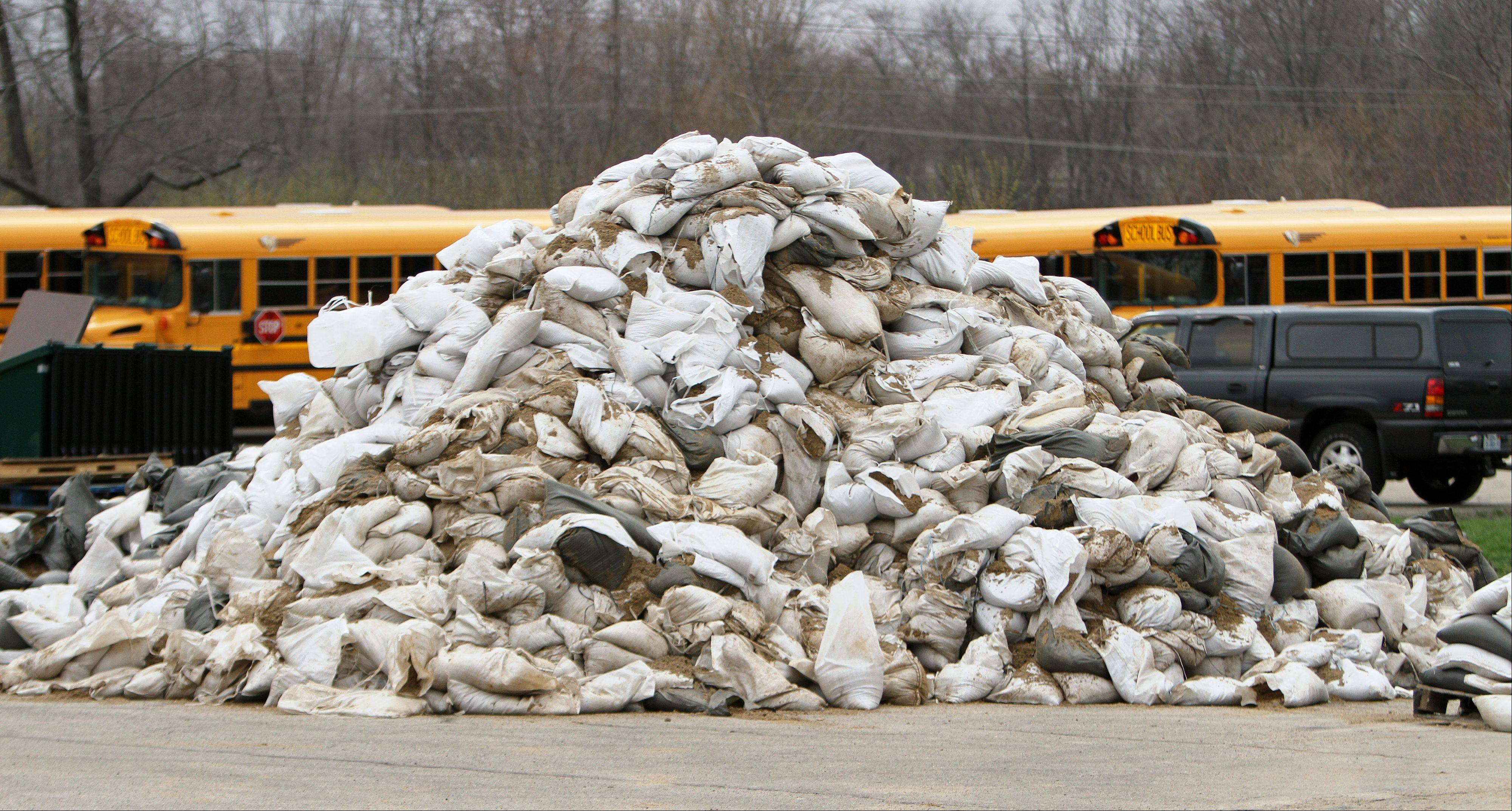 A mound of used sandbags sits behind Gurnee Grade School on Monday as the Federal Emergency Management Agency checked out flood damage in the community.