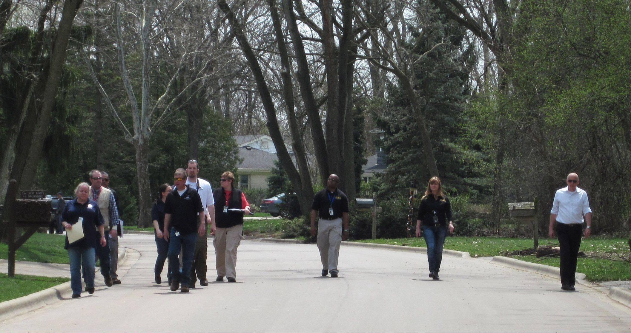 State and federal officials on Monday visit several flood-stricken areas in Lake County, including this neighborhood in Lincolnshire, as part of a preliminary damage assessment.