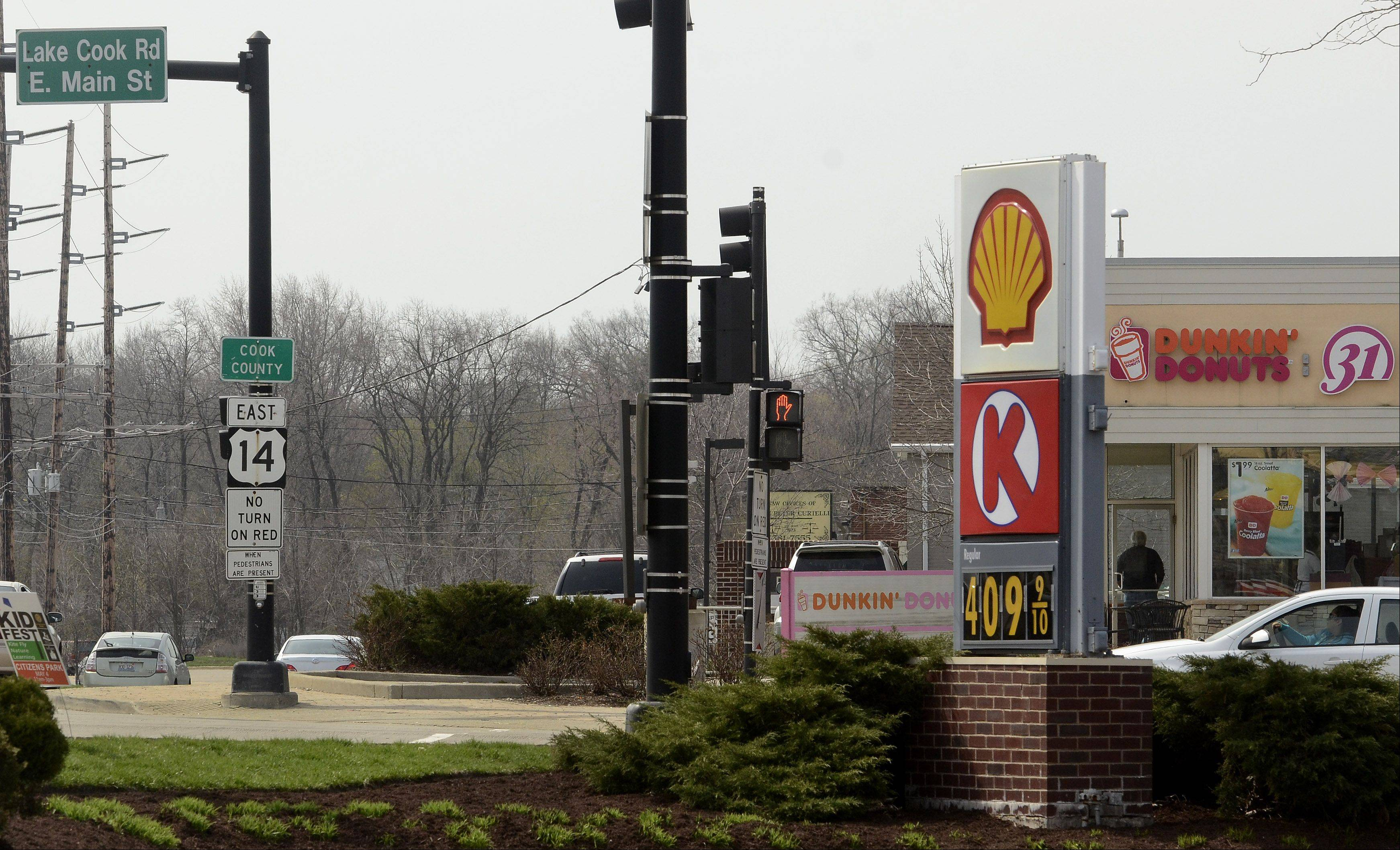 Under a proposal to allow concealed carry except in Cook County, customers of a Shell station on Lake-Cook Road in Barrington could legally carry weapons, while visitors to a Dunkin' Donuts across the street would be barred from carrying guns.