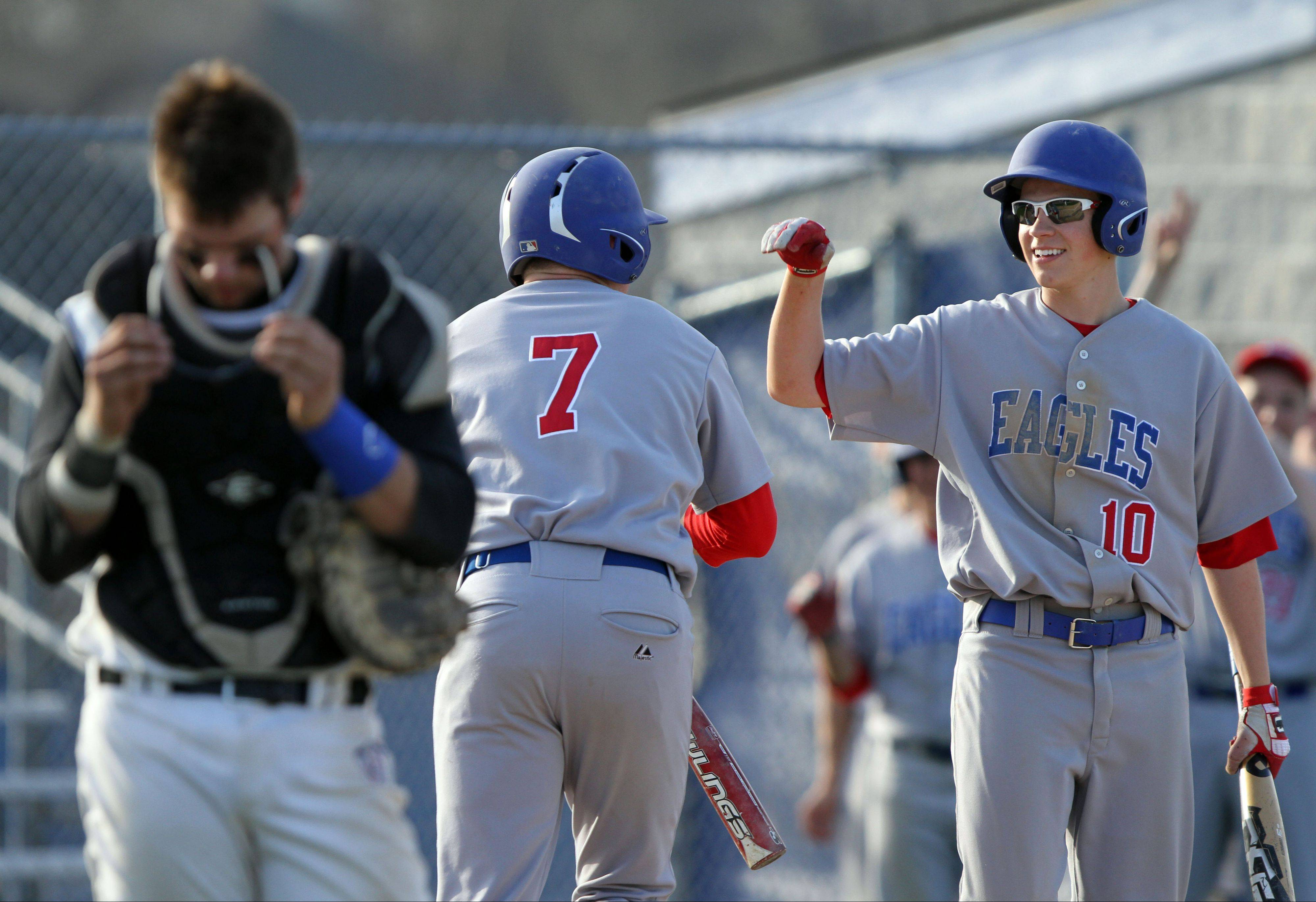 Lakes' Nick Seketa, left, congratulates Eric Kuhlmann after scoring Tuesday at Lake Zurich.
