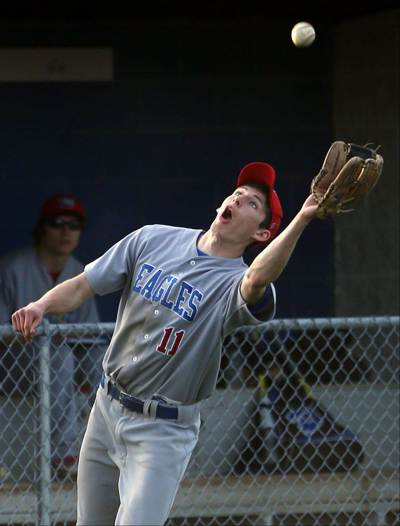 Steve Lundy/slundy@dailyherald.comLakes' Kyle Vanderwall makes a catch in foul territory as the ball drifts close to their bench during their game Tuesday at Lake Zurich High School.
